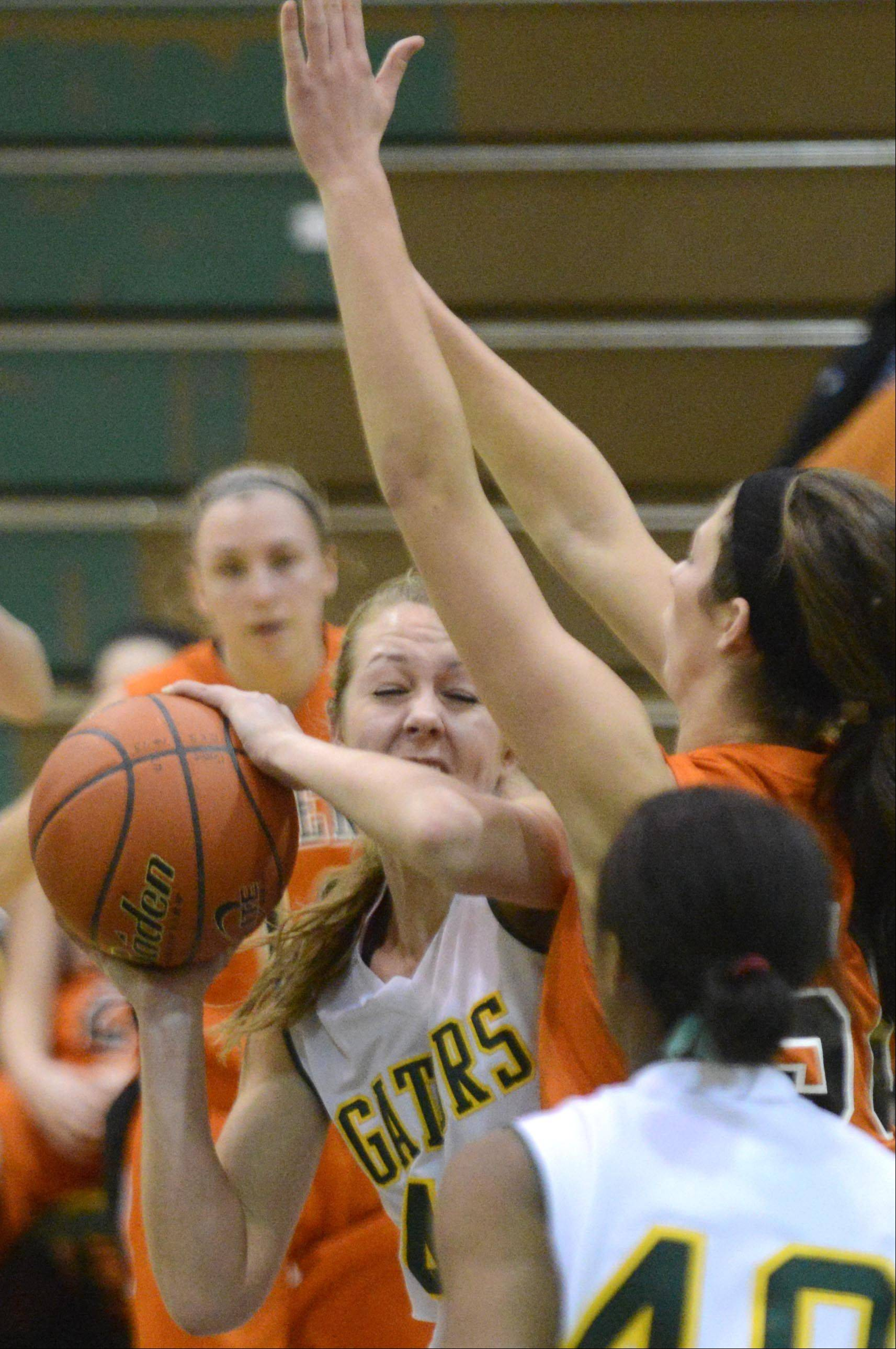 Crystal Lake South's Lauren Del Vecchio runs into the defense of McHenry's Brittany Avonts Wednesday in Crystal Lake.