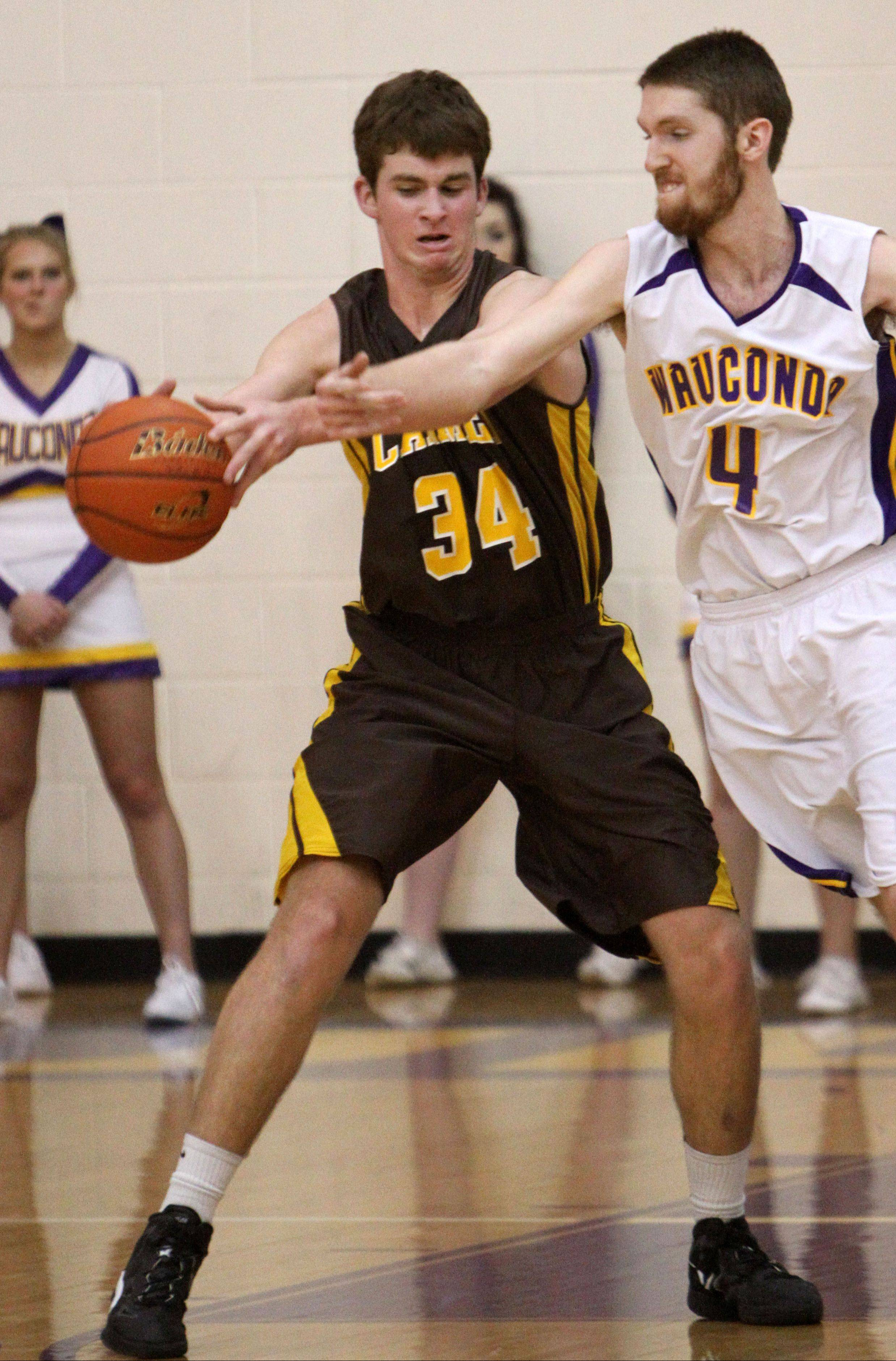 Wauconda's Ricky Sidlowski, right, tries to steal the ball from Carmel's Cullen Barr on Wednesday night in Wauconda.