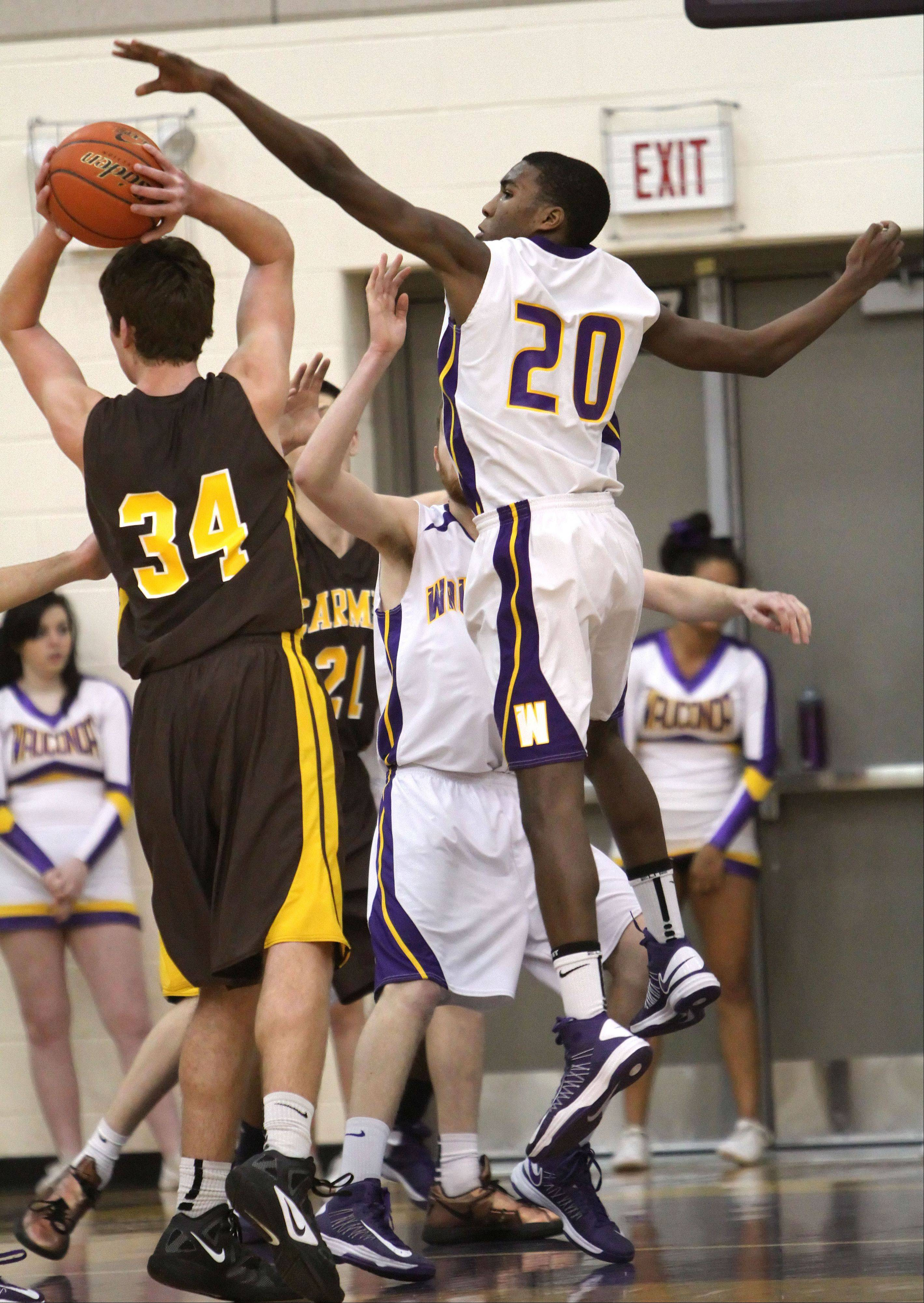 Wauconda's Devon King, right, tries to block the shot of Carmel's Cullen Barr on Wednesday night in Wauconda.