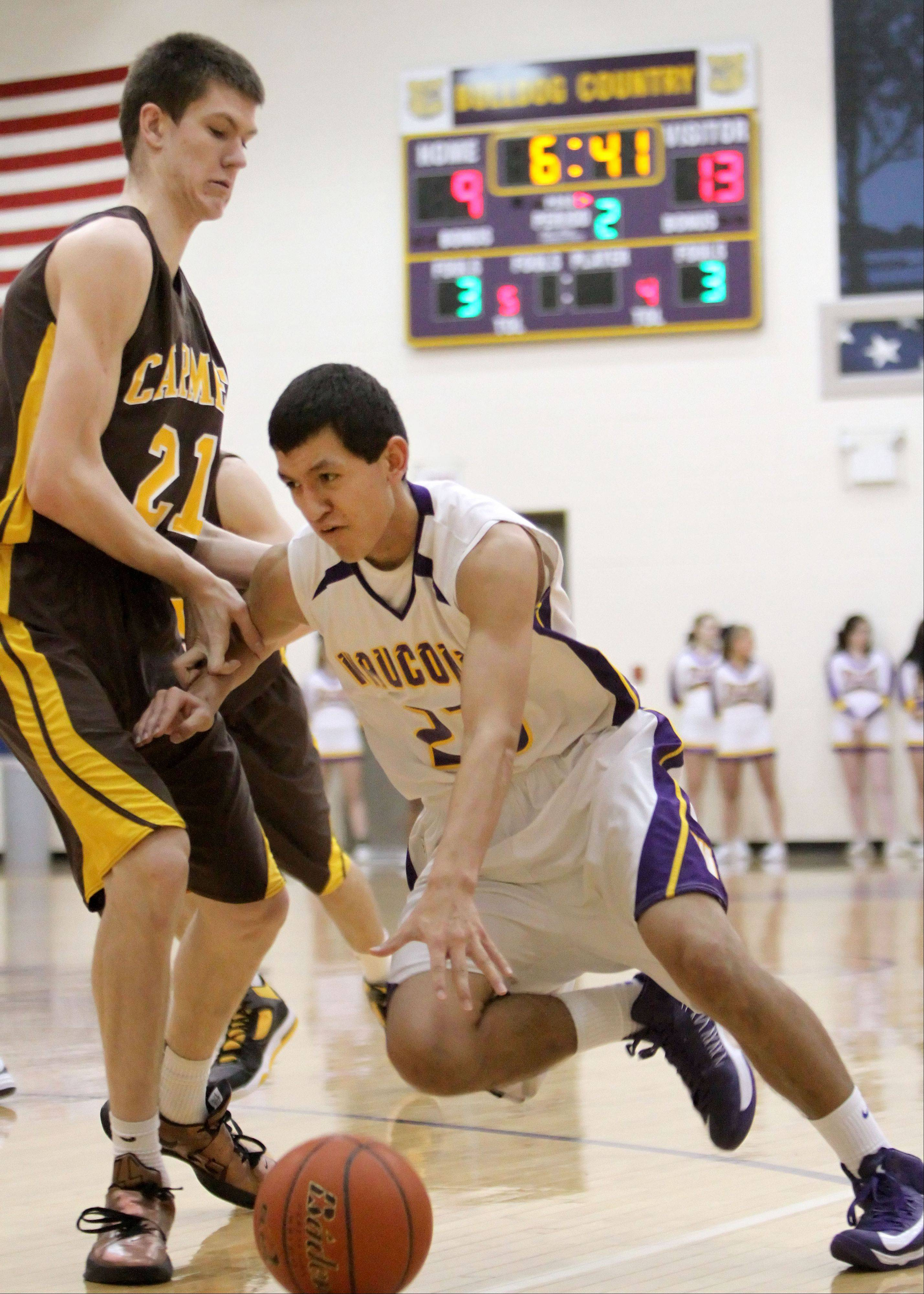 Wauconda's Kodey Thomas, right, drives on Carmel's Jack George on Wednesday night in Wauconda.