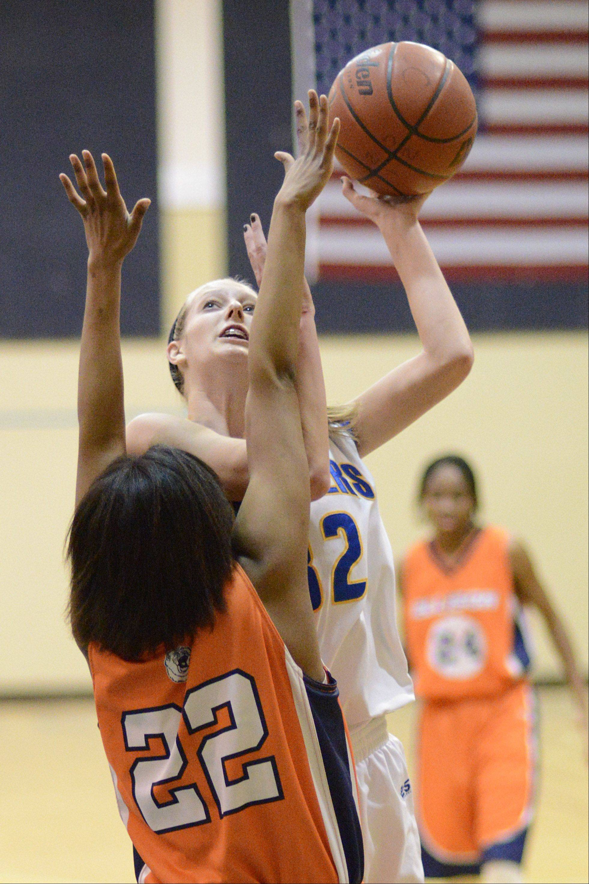 Aurora Central Catholic's Alex Horton shoots over CICS Ellison's Briana Stamps in the second quarter.