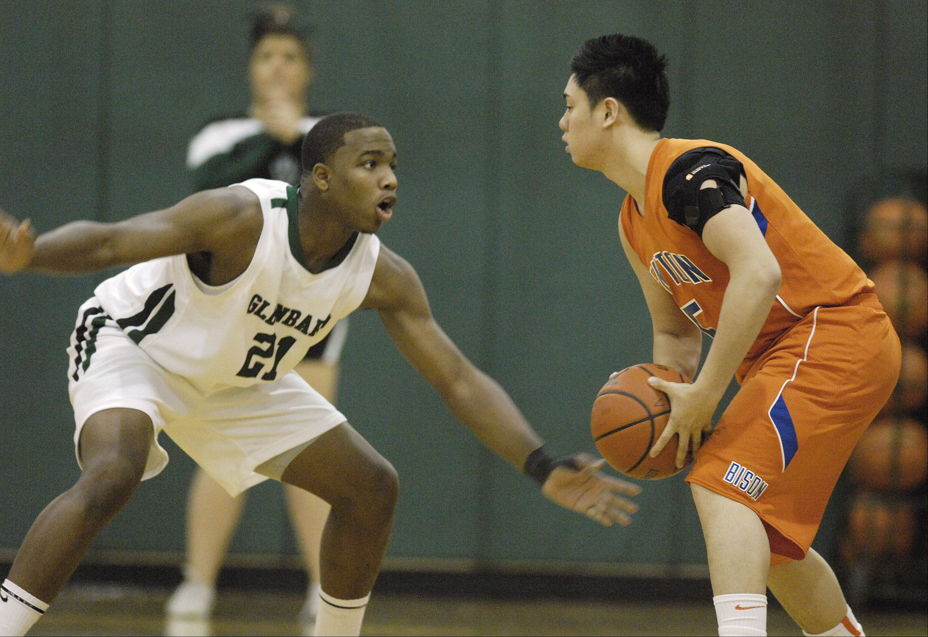 Jeff Levesque of Glenbard West guards Herman DeGuia of Fenton during the 10th annual Glenbard West boys basketball Christmas Classic, Wednesday, December 28, 2011 in Glen Ellyn.