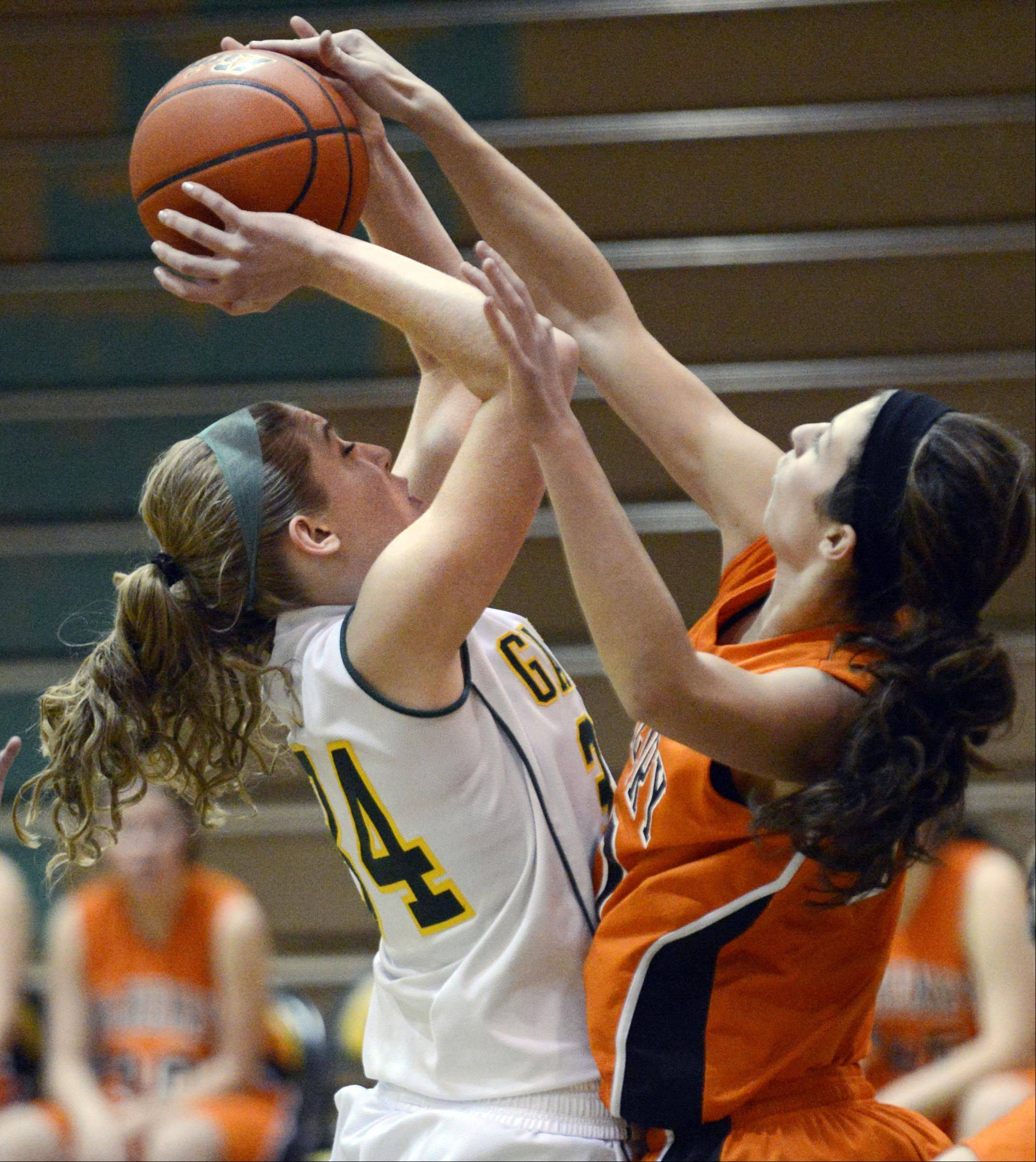 Crystal Lake South's Sara Mickow has her shot blocked by McHenry's Brittany Avonts.