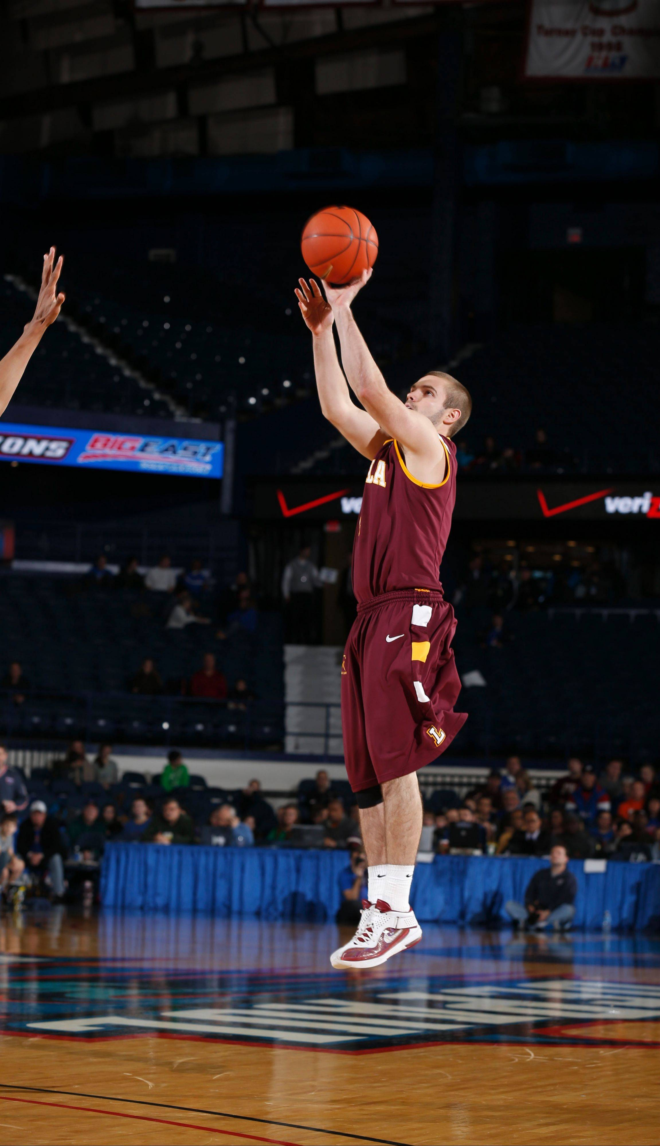 Cully Payne elevates for a jumper in Loyola's recent victory over DePaul.