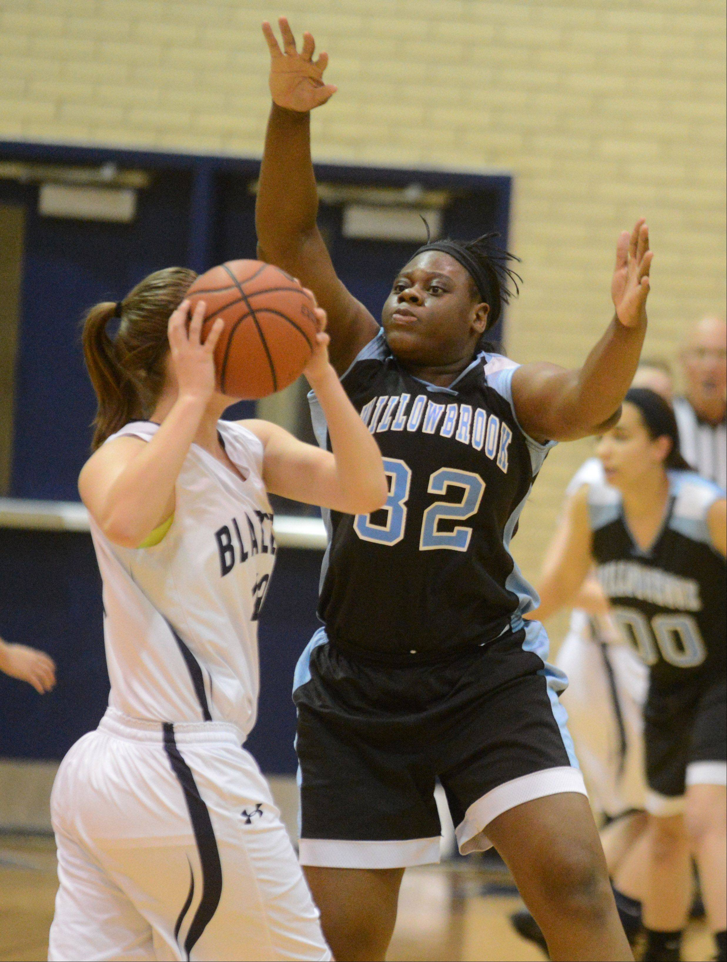 Kelly Baumgartner of Addison Trail looks to pass around Erma Udota of Willowbrook.