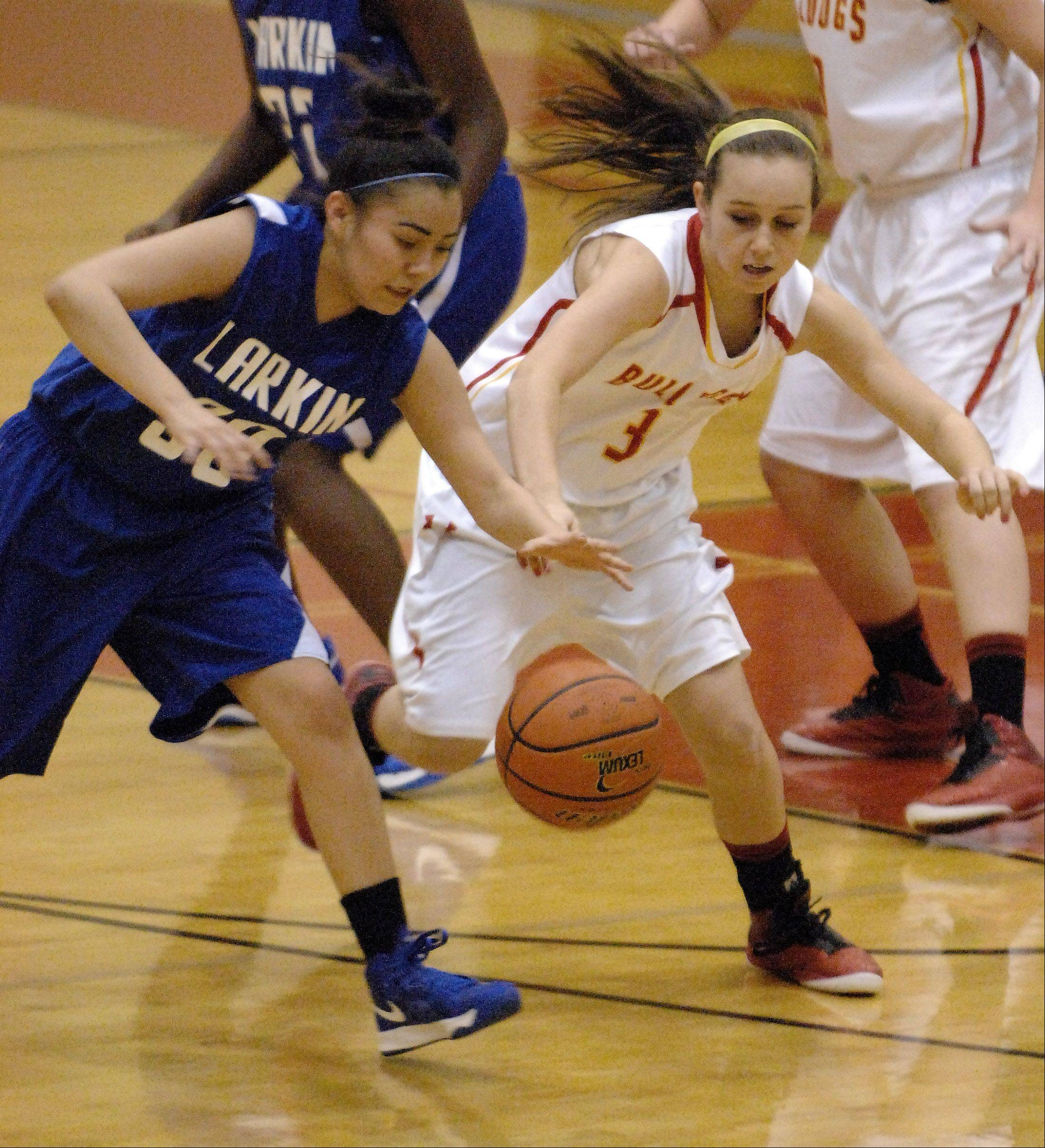 Batavia's Bethany Orman and Larkin's Sky Evans battle for a loose ball.