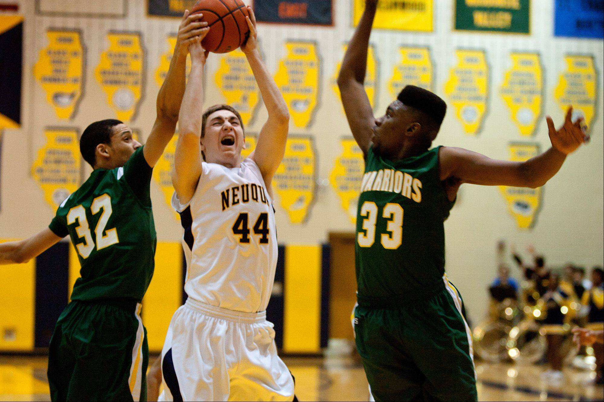 Neuqua Valley's Trevor Davis, center, battles Waubonsie Valley's Bryan Jefferson and Javares Stewart.