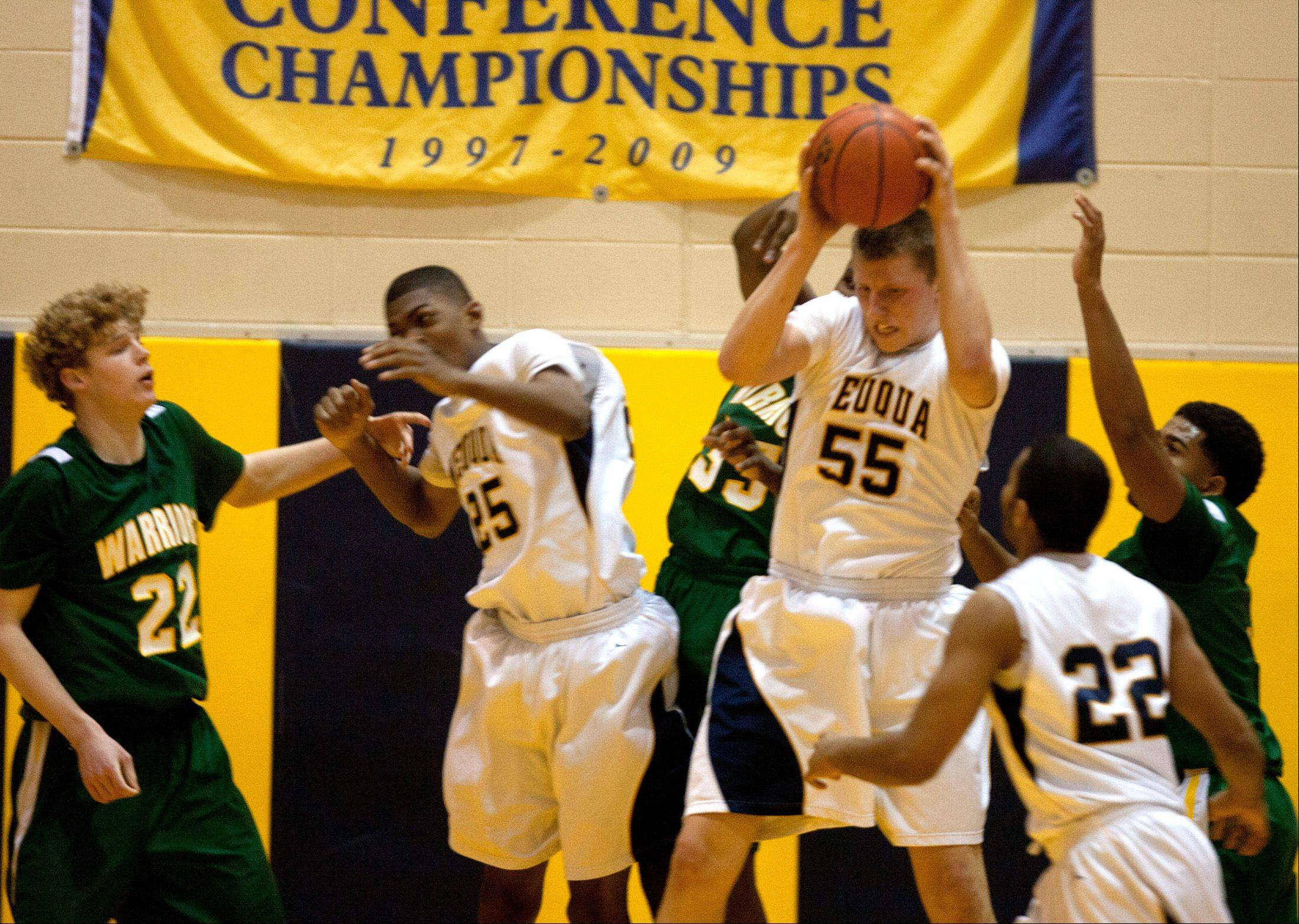Neuqua Valley's Pat Kenny (55), gathers a rebound against Waubonsie Valley during boy's basketball action in Naperville.
