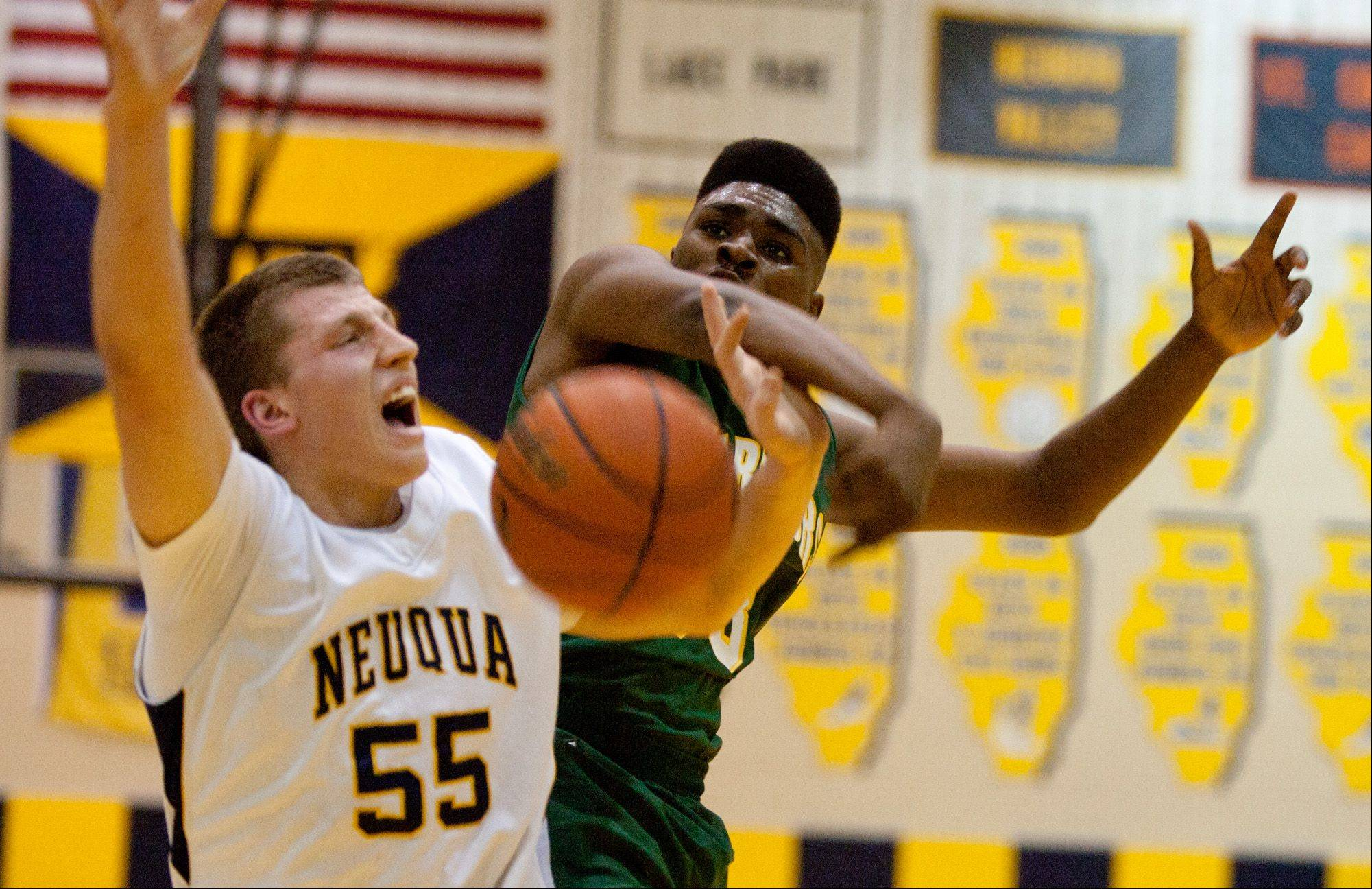 Neuqua Valley's Pat Kenny (55) has his shot blocked by Waubonsie Valley's Javares Stewart, right, during boy's basketball action in Naperville.