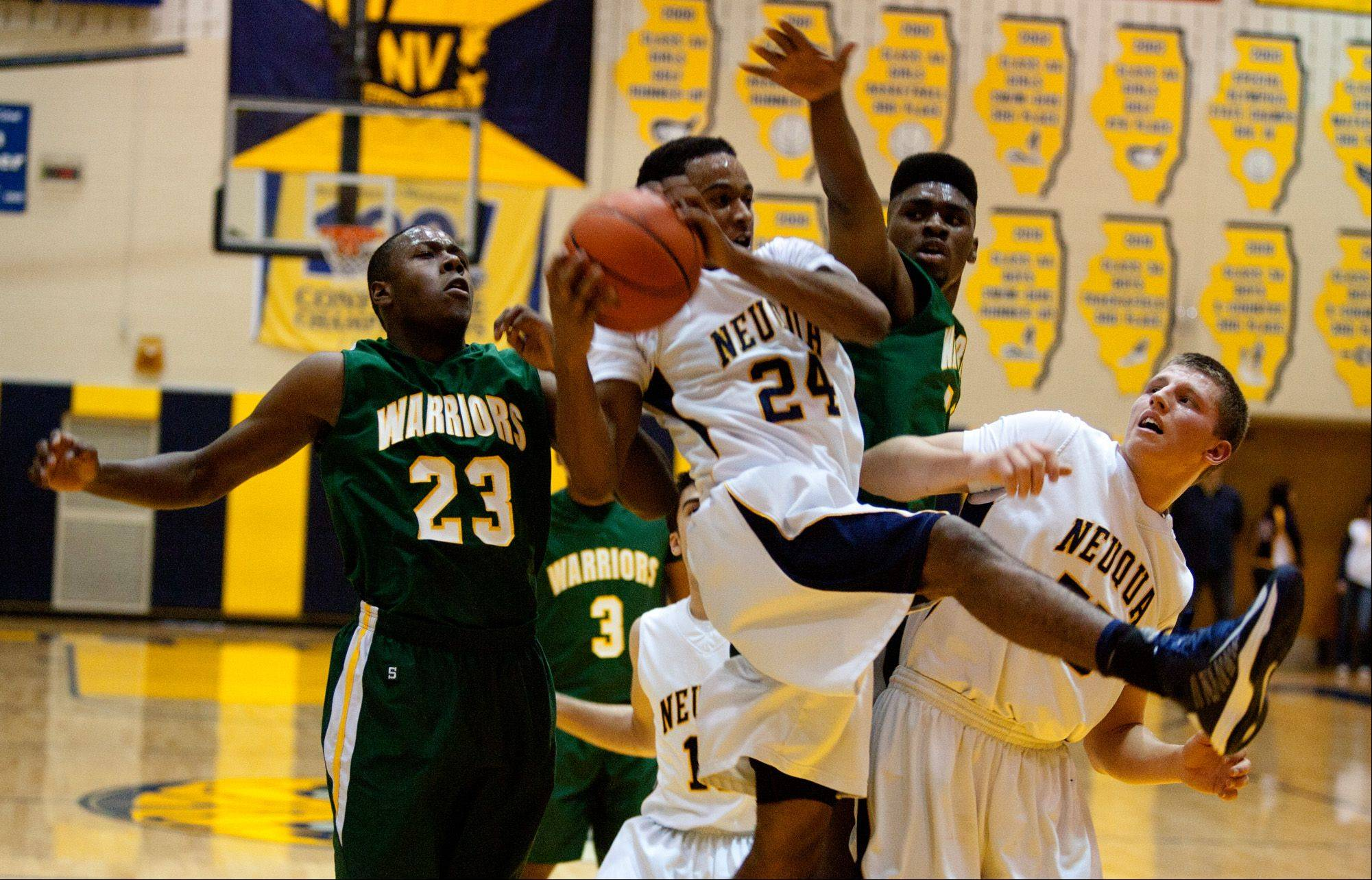 Neuqua Valley's Jabari Sandifer (24), gathers a rebound against Waubonsie Valley during boy's basketball action in Naperville.