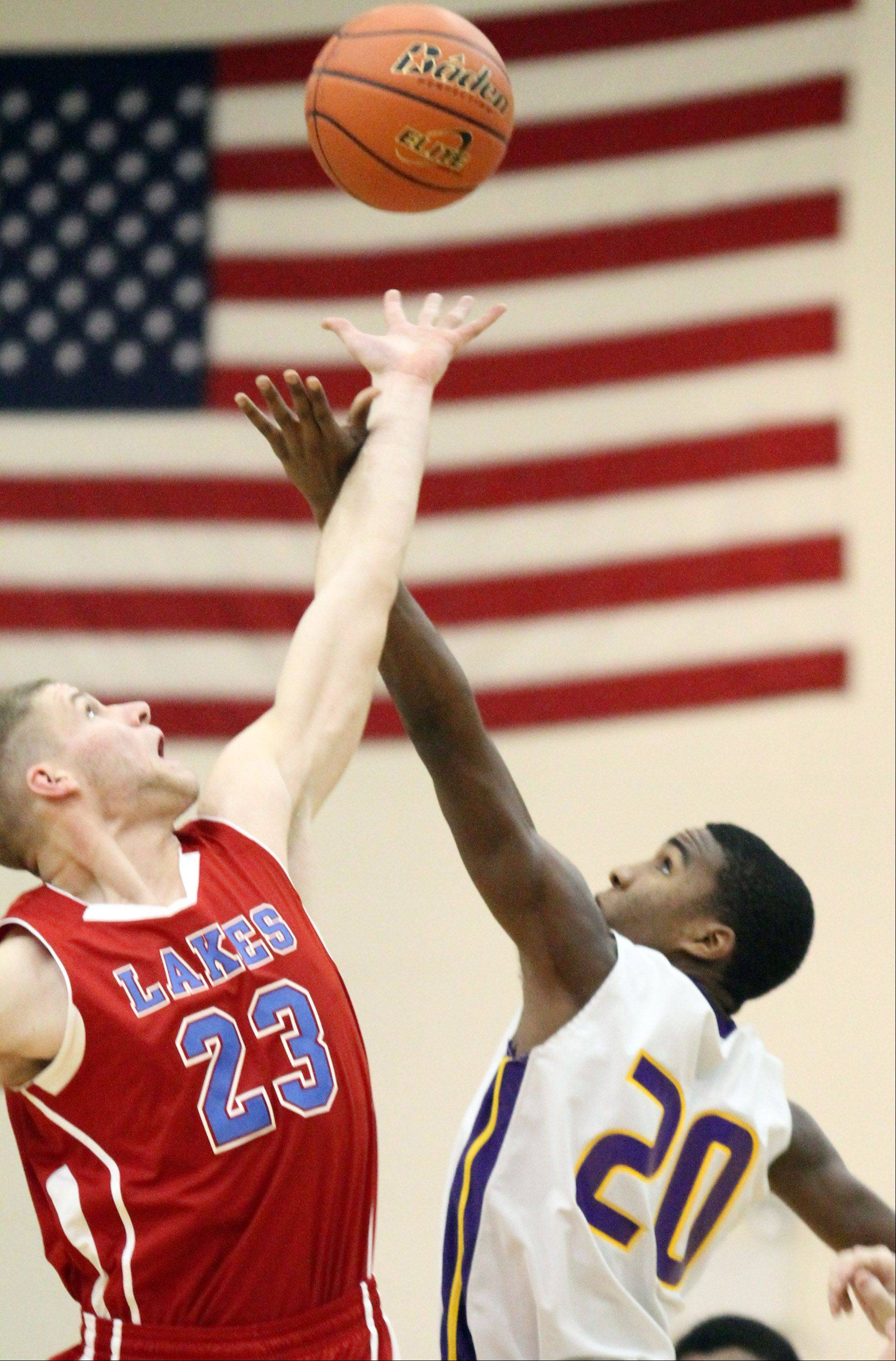 Lakes' Jake Kohler and Wauconda's Devon King tip off at Wauconda on Friday.