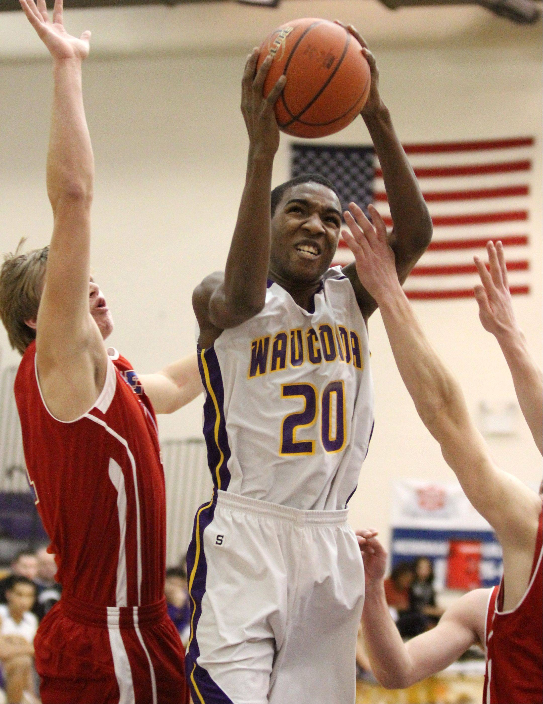 Wauconda's Devon King puts the ball up against a Lakes defender at Wauconda on Friday.