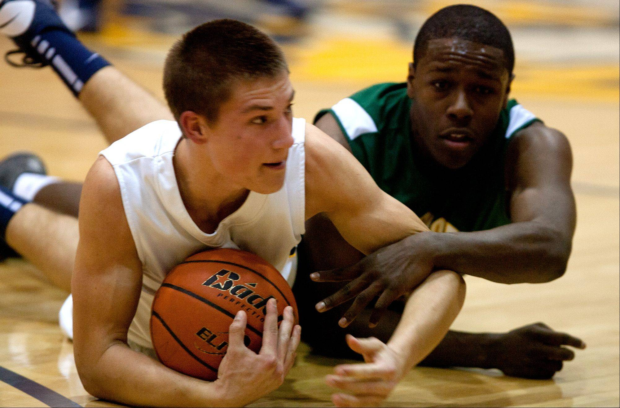 Neuqua Valley's Brad Mikulecky, left, battles Waubonsie Valley's Jared Brownridge, right.