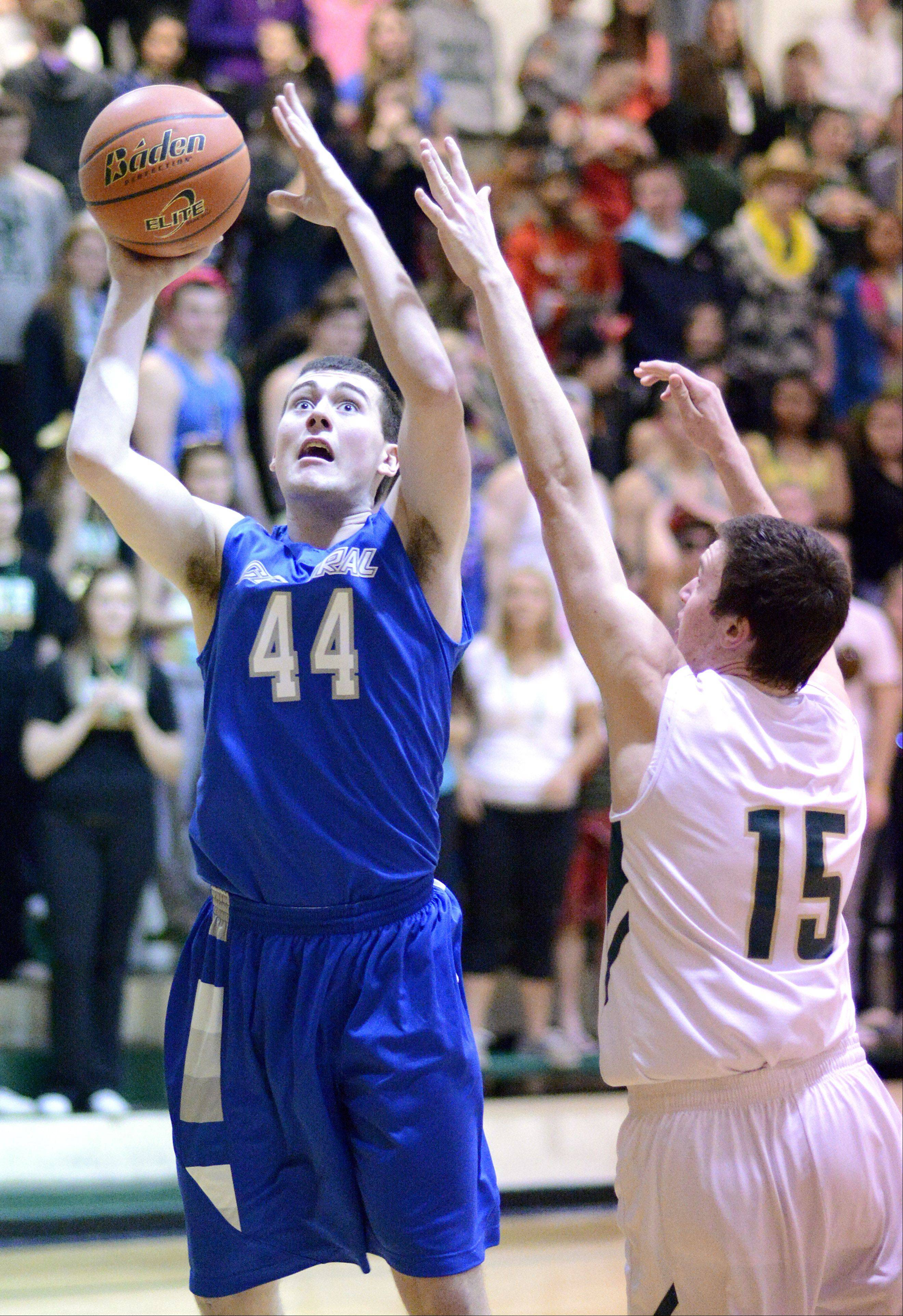 Burlington Central's Zach Berry shoots past a block attempt by St. Edward's Nick Duffy in the third quarter on Friday at St. Edward.
