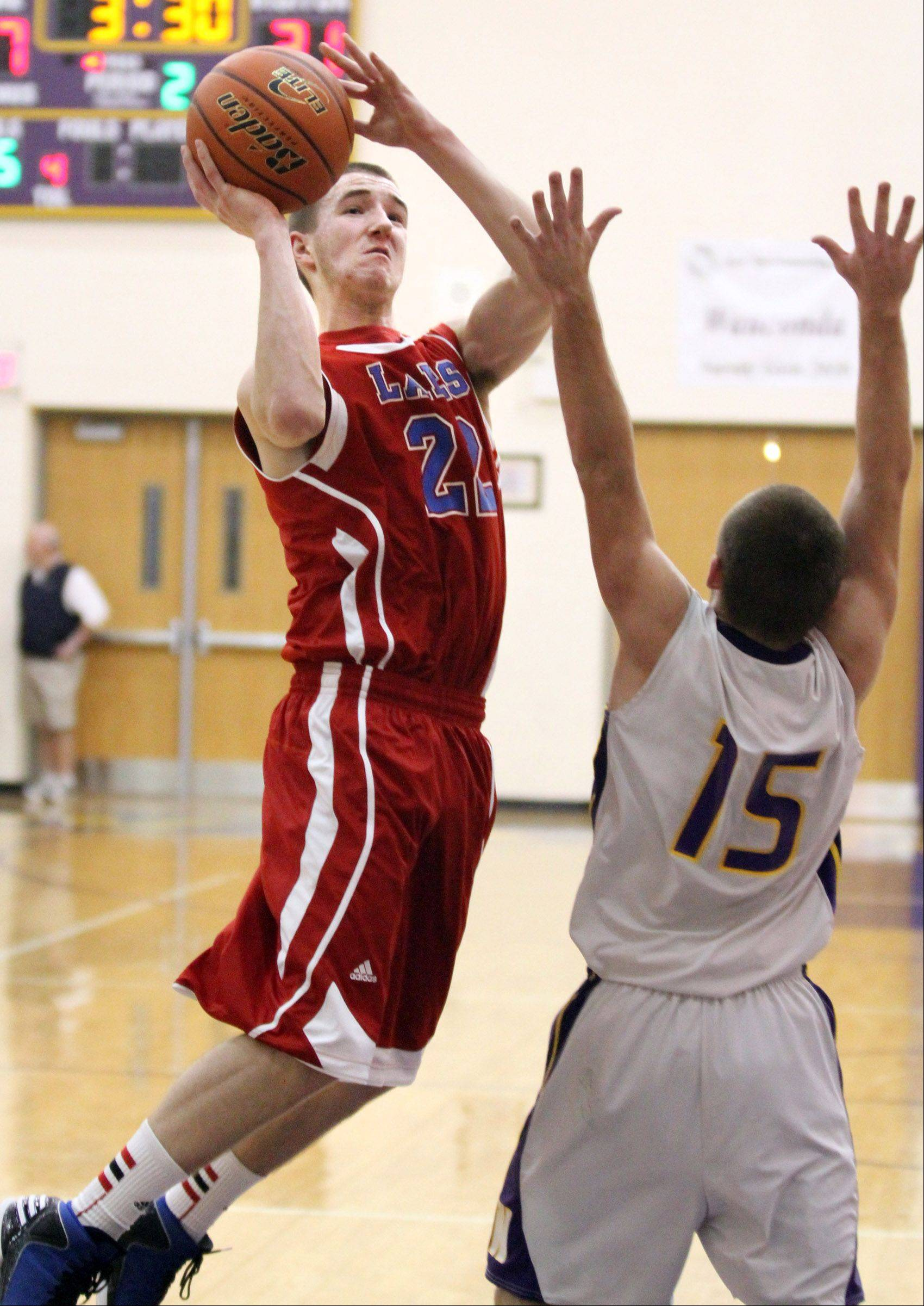 Lakes' point guard Troy Swindle shoots over Wauconda defender Keith Blomberg.