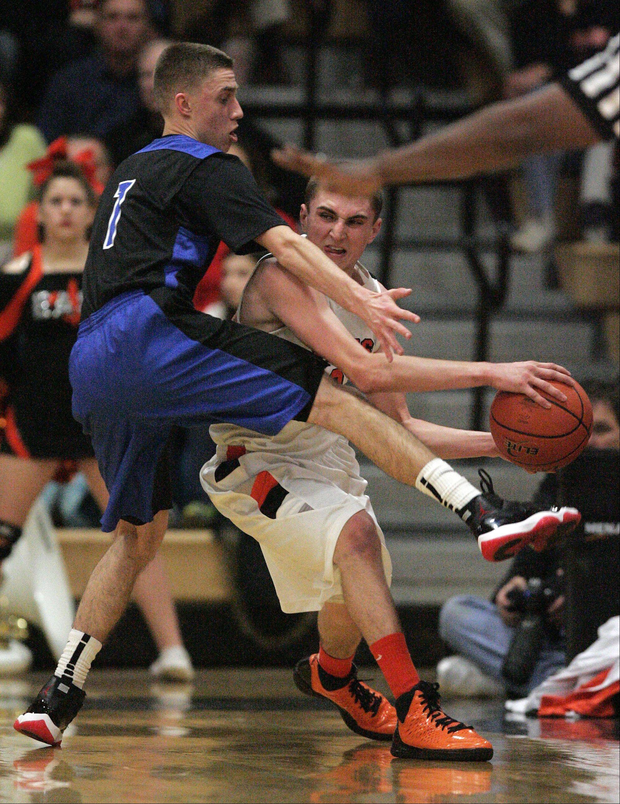 St. Charles North's Alec Goetz pressures St. Charles East's Dom Adduci.
