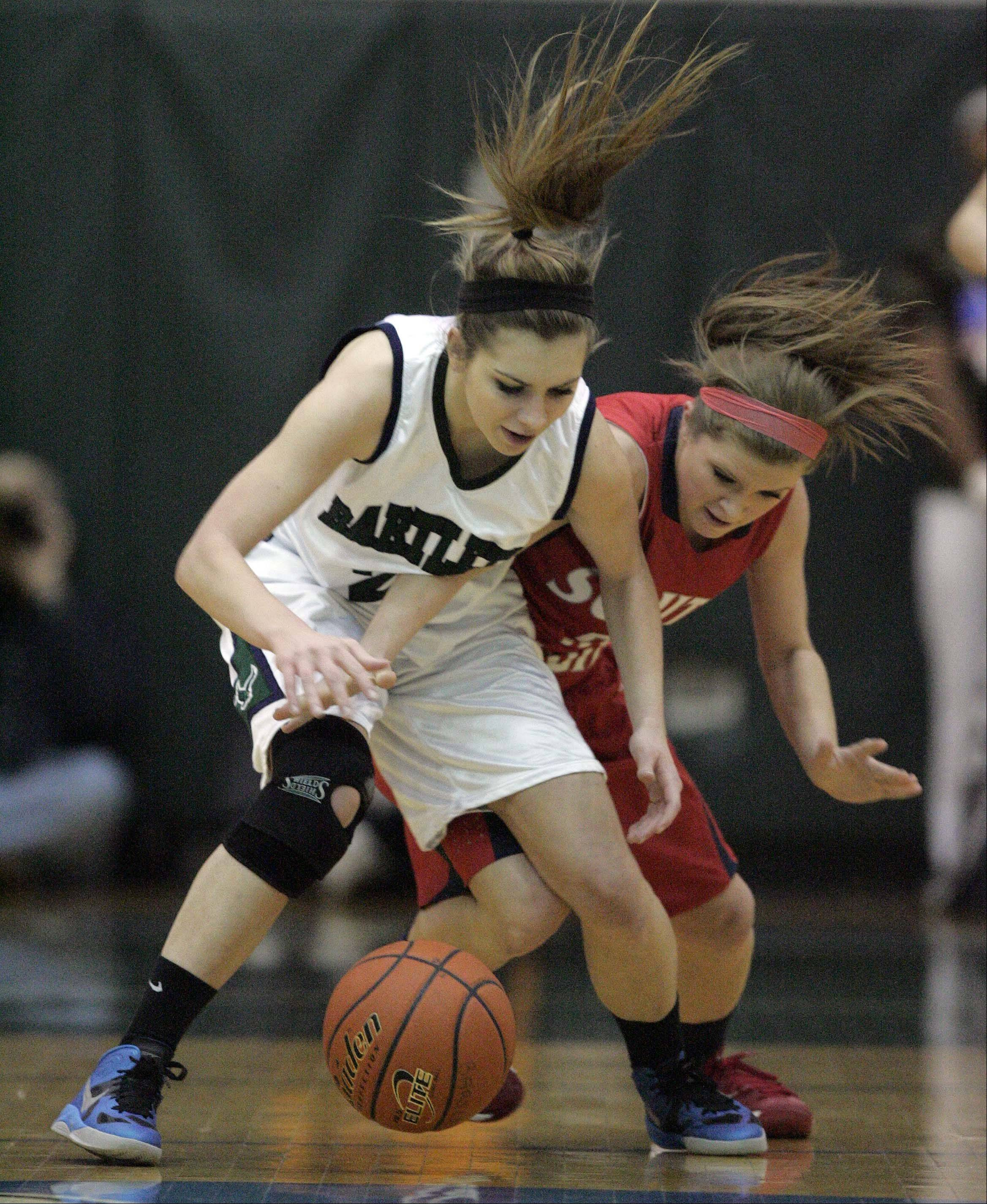 Bartlett's Chantel Zasada, 21 goes head to head with South Elgin's Anna Tracy, 5, as they fight for a loose ball during girls basketball at Bartlett Saturday January 19, 2013.