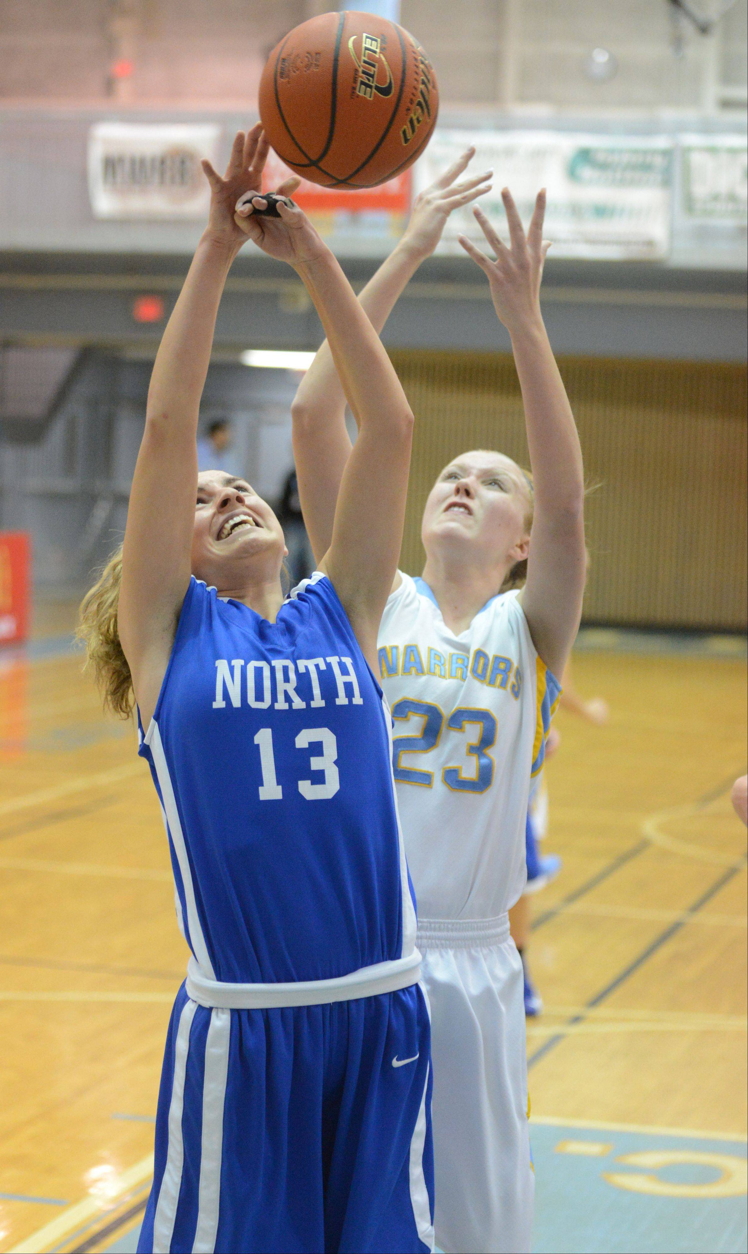 Ashley Collins of Main West,right, and Brooke Schanowski of Wheaton north go for a rebound during the Wheaton North vs. Maine West girls basketball game at McDonald's Shootout in Willowbrook Saturday.
