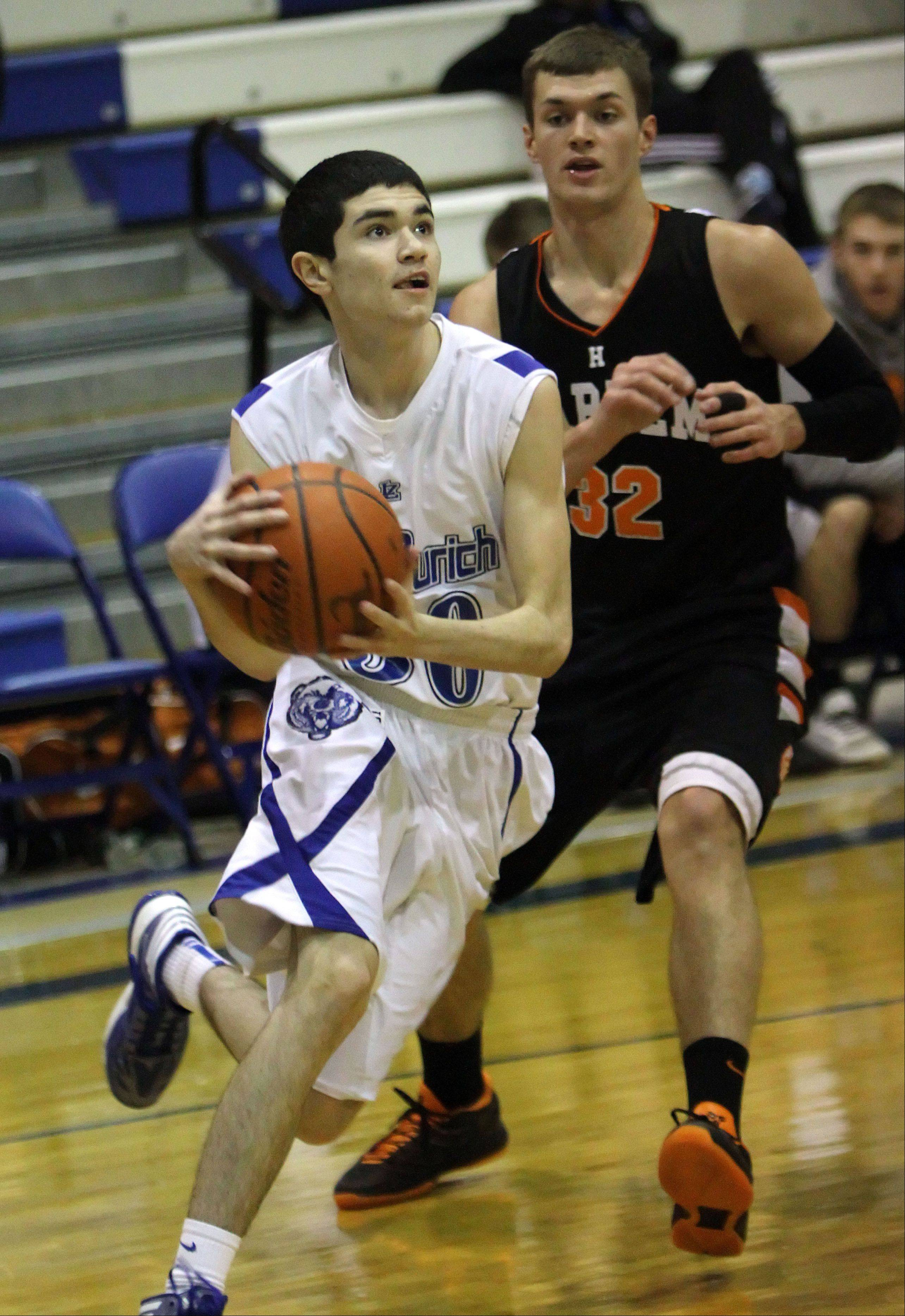 Lake Zurich's Jack O'Neill, left, drives on Harlem's Josh Cass on Monday night at Lake Zurich.