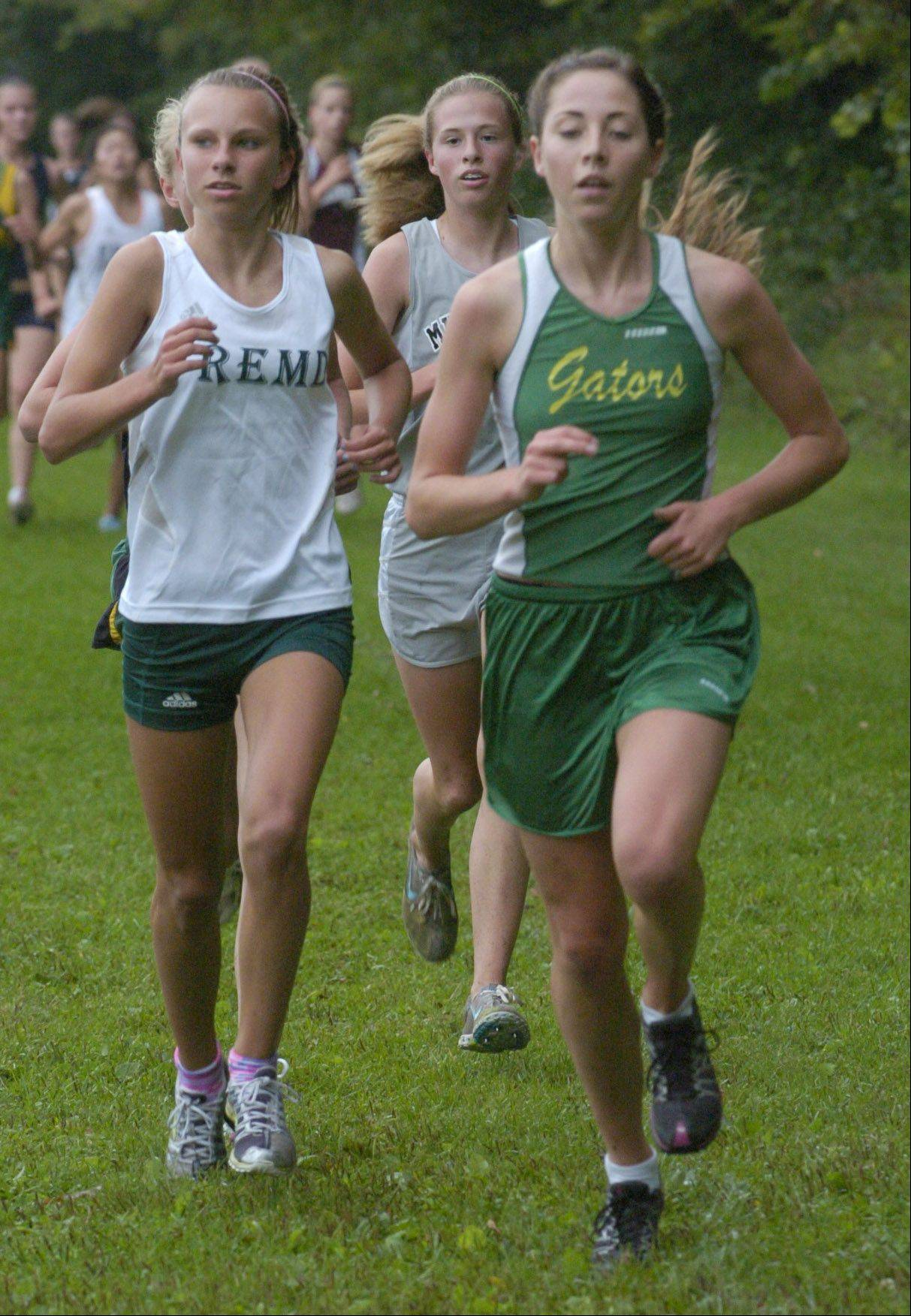 Fremd's Kelly Breen, left, runs alongside Crystal Lake South's Marianne Collard during Saturday's cross country meet at Warren.