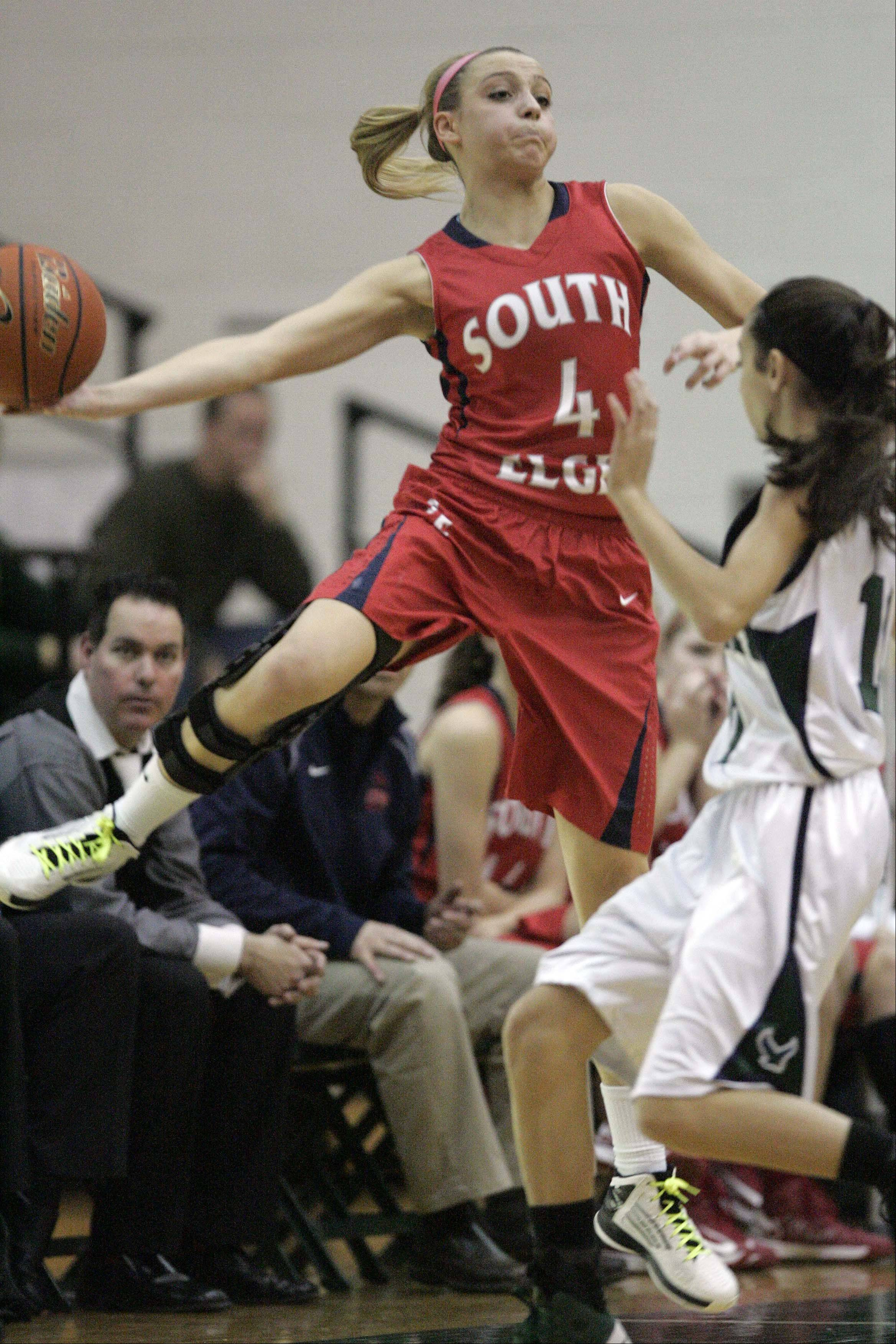 South Elgin junior Savanah Uveges (4) leaps out of bounds as she tries to save an errant pass during the Storm's win at Bartlett Saturday.