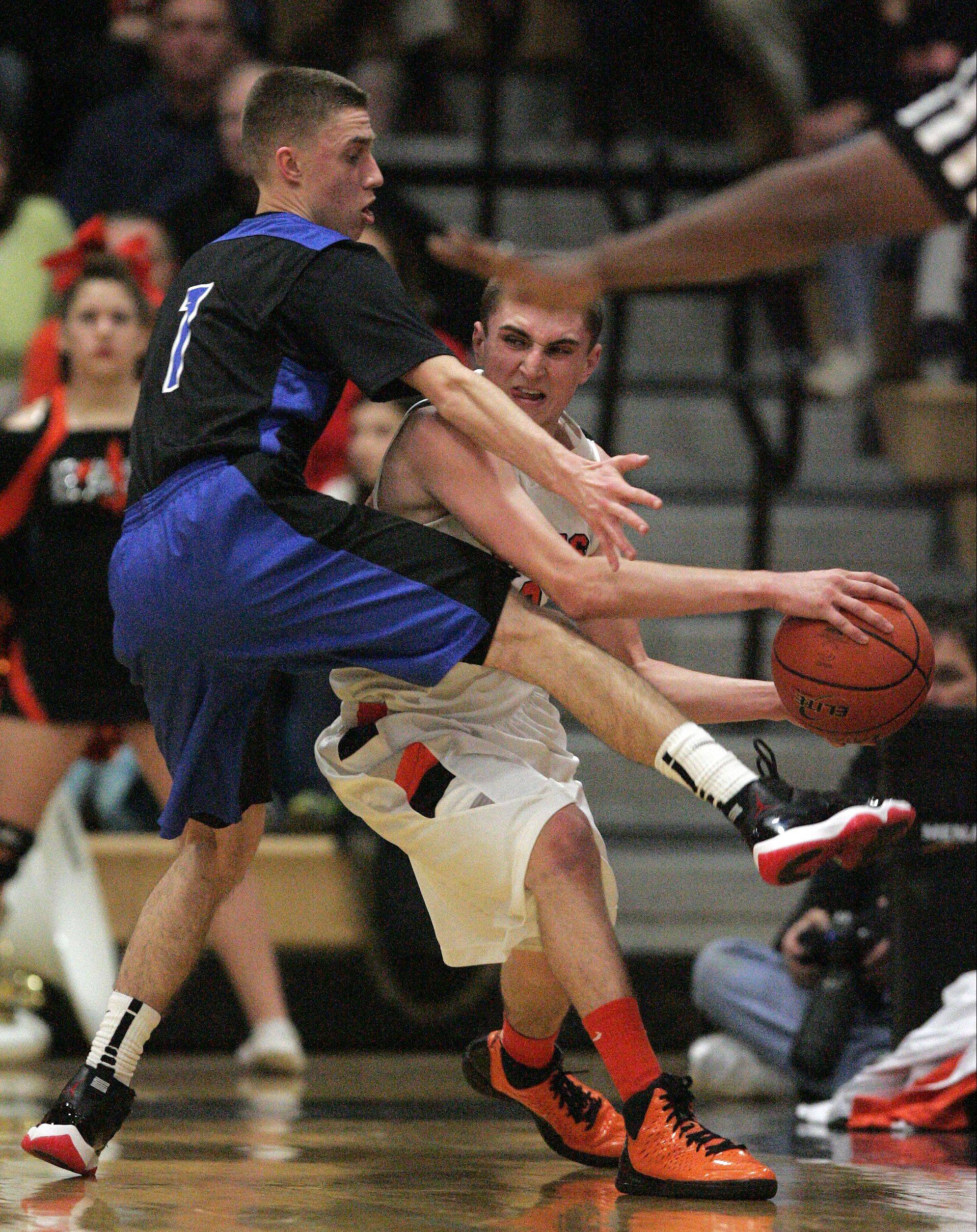 St. Charles North's Alec Goetz, 1, pressures St. Charles East's Dom Adduci, 2, during boys basketball Friday January 18, 2013.