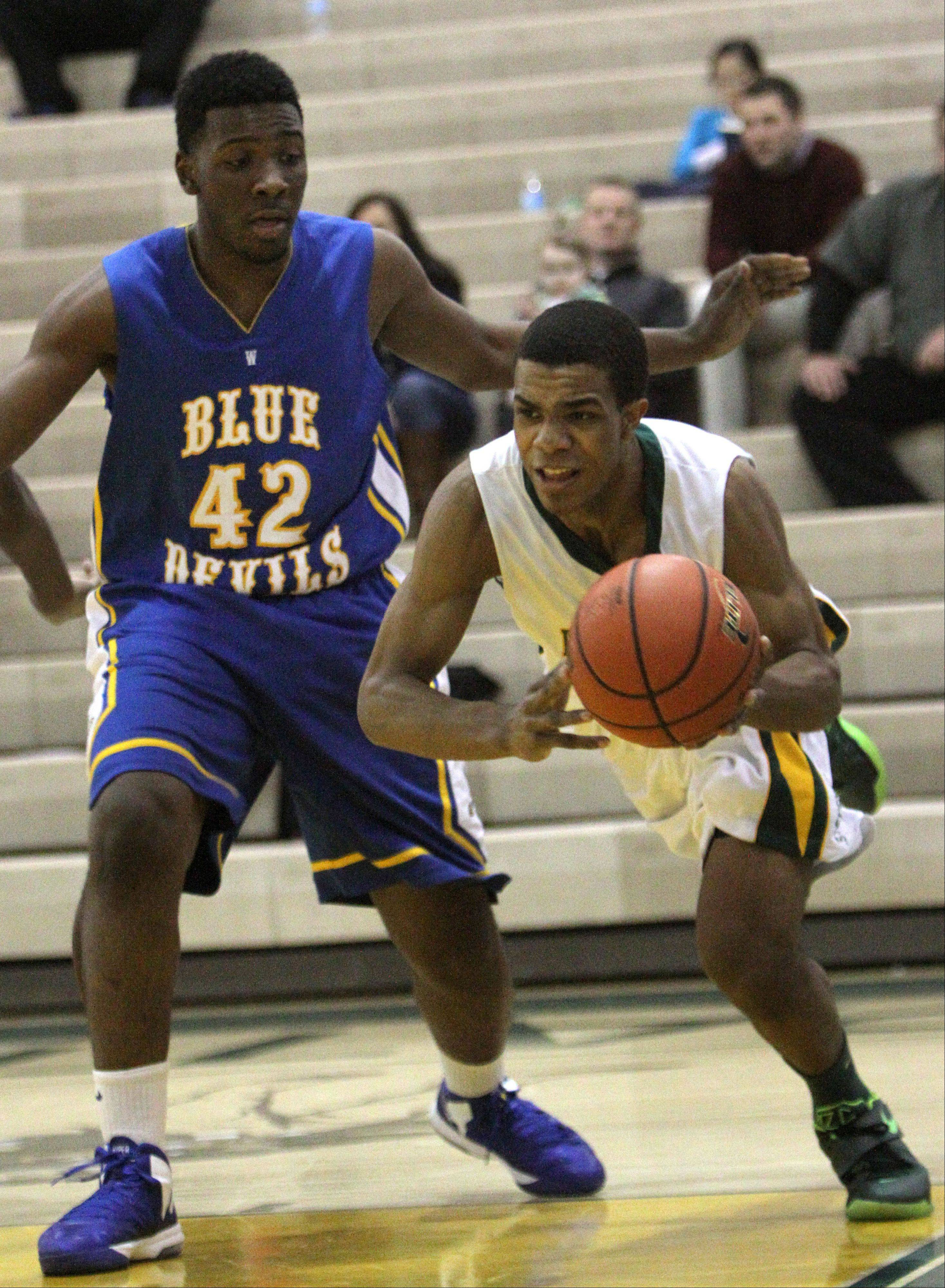 Stevenson's Connor Cashaw, right, drives on Warren's Dre Von Hill on Tuesday night at Stevenson.