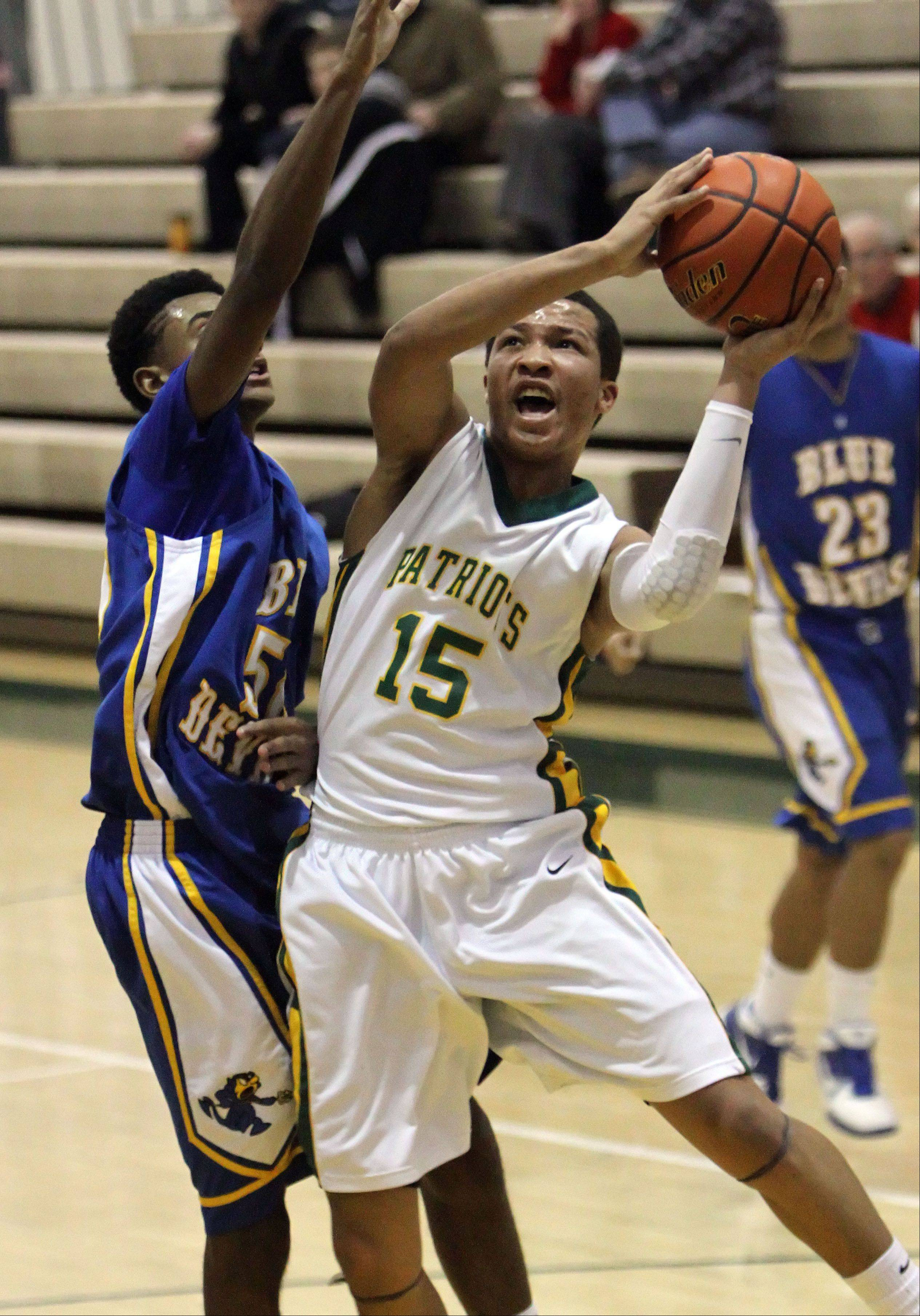 Stevenson's Jalen Brunson, right, drives on Warren's Adrian Deere on Tuesday night at Stevenson High School.