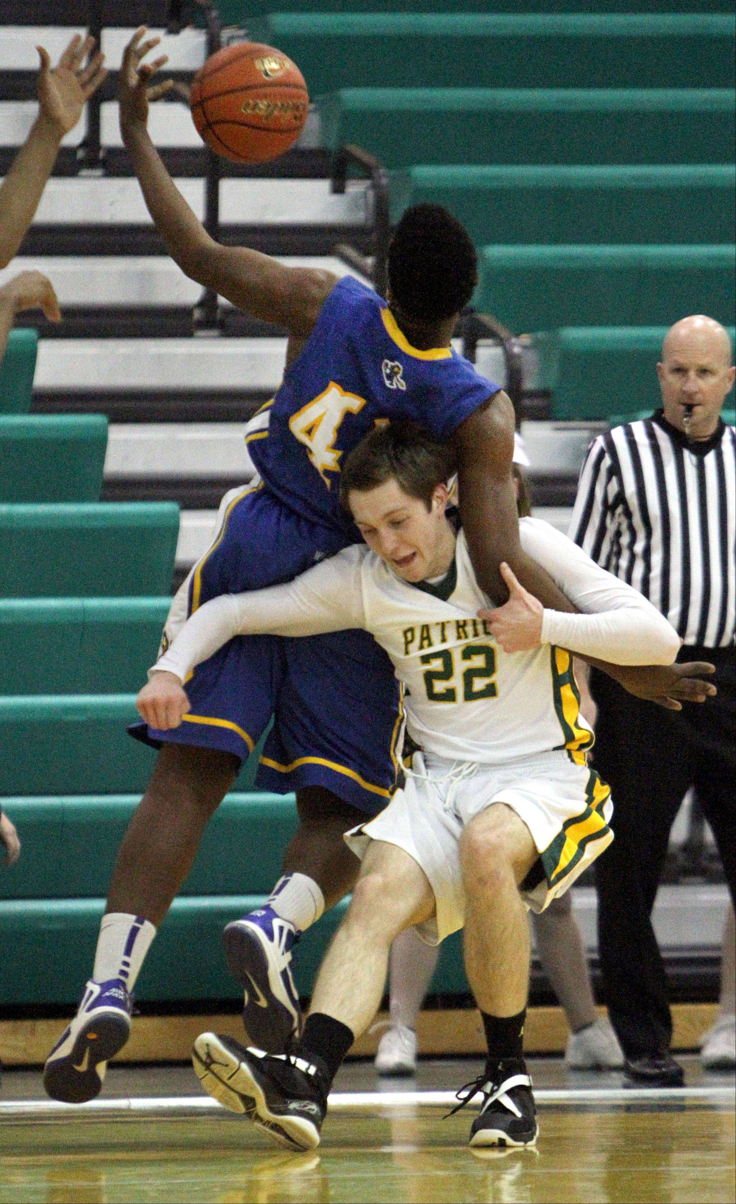Warren's Dre Von Hill, left, and Stevenson's John Duffy battle for a rebound Tuesday night at Stevenson.