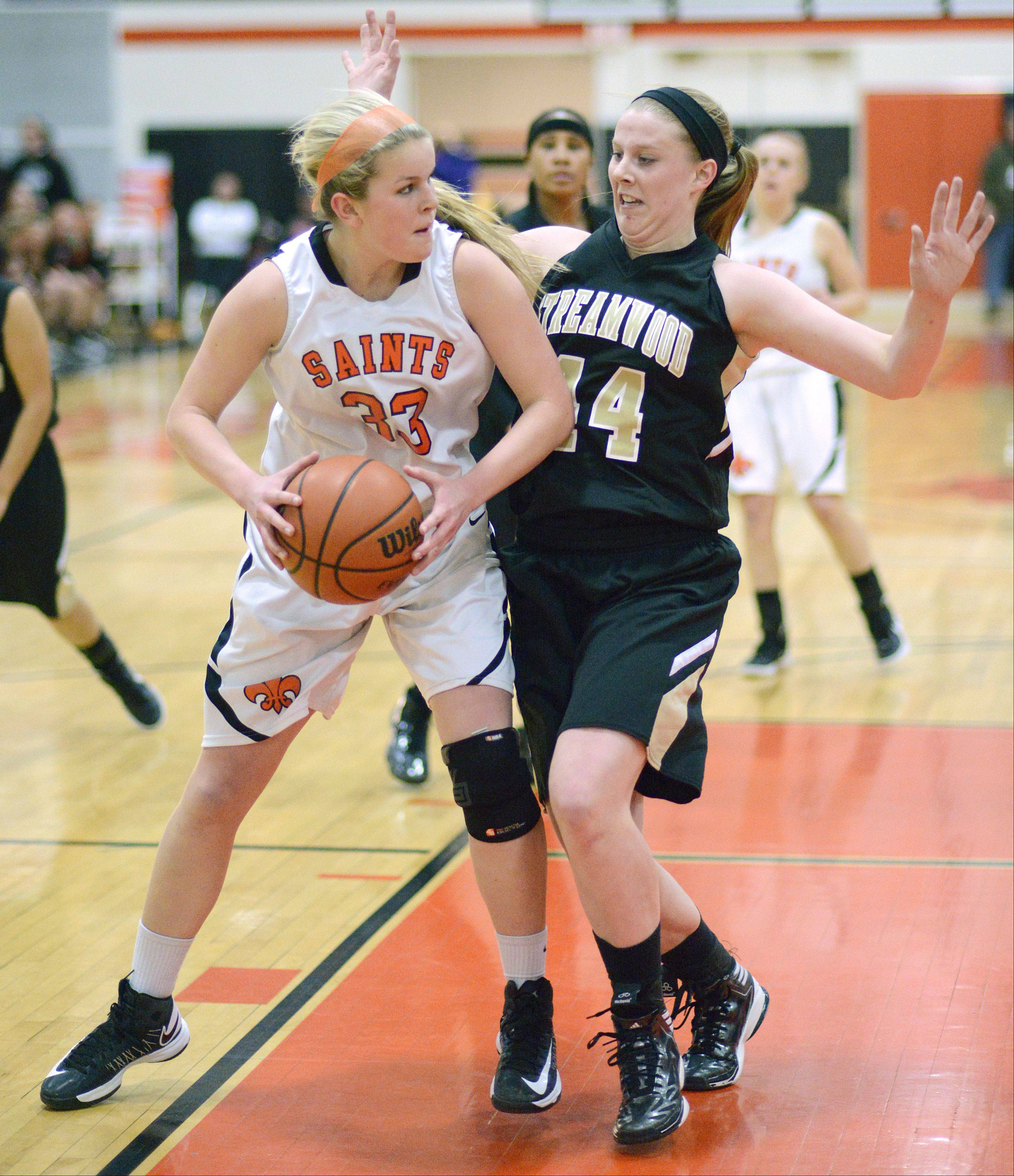 Streamwood's Hannah McGlone attempts to block a pass by St. Charles East's Hannah Nowling in the first quarter on Tuesday, January 22.