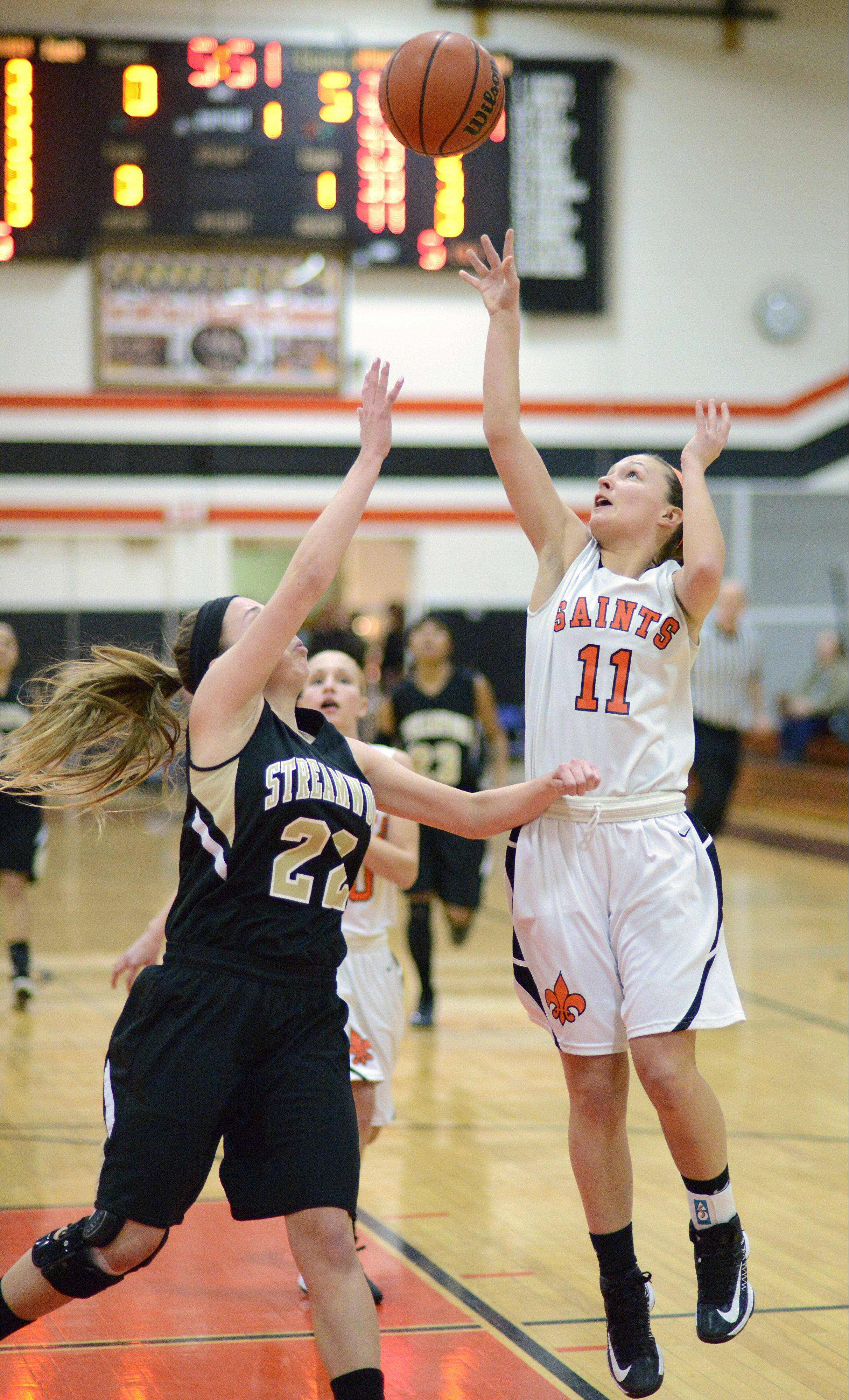 St. Charles East's Carly Pottle shoots over Streamwood's Holley Foret Tuesday in St. Charles.