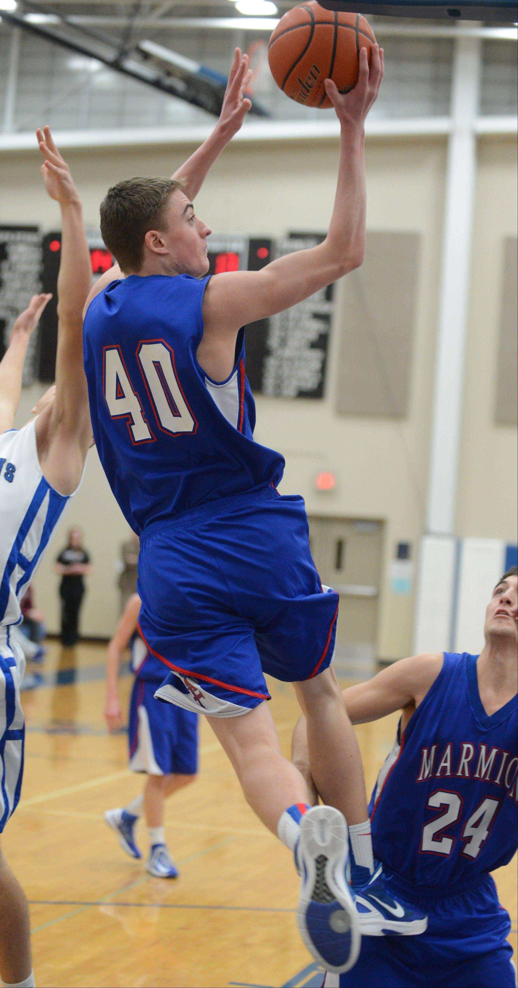 Tyler Maryanski of Marmion gets some air on the way to the net. This took place during the Marmion at St. Francis boys basketball game Tuesday in Wheaton