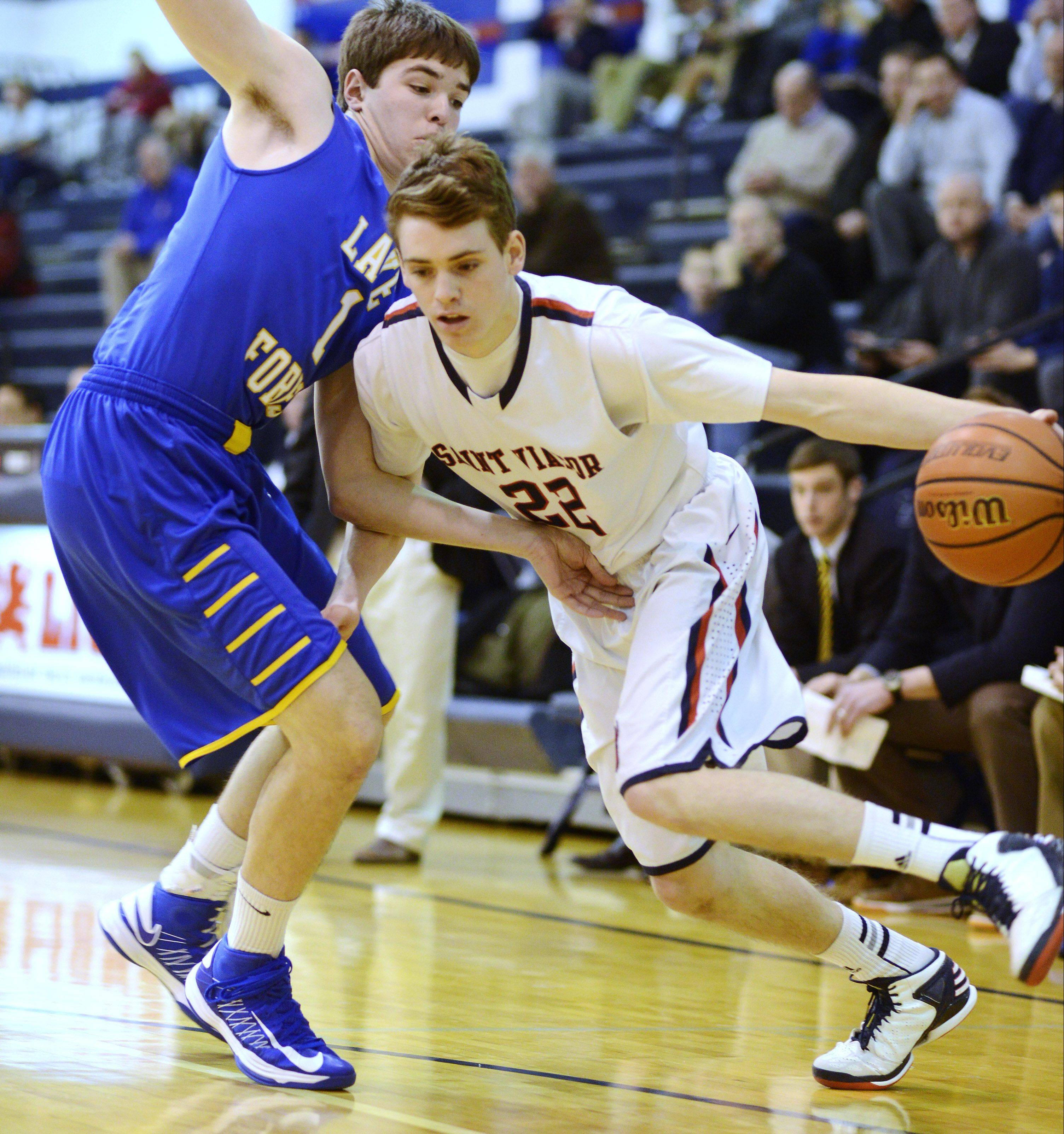St. Viator's Patrick Martin, right, drives against Lake Forest defender Ben Simpson during Tuesday's game.