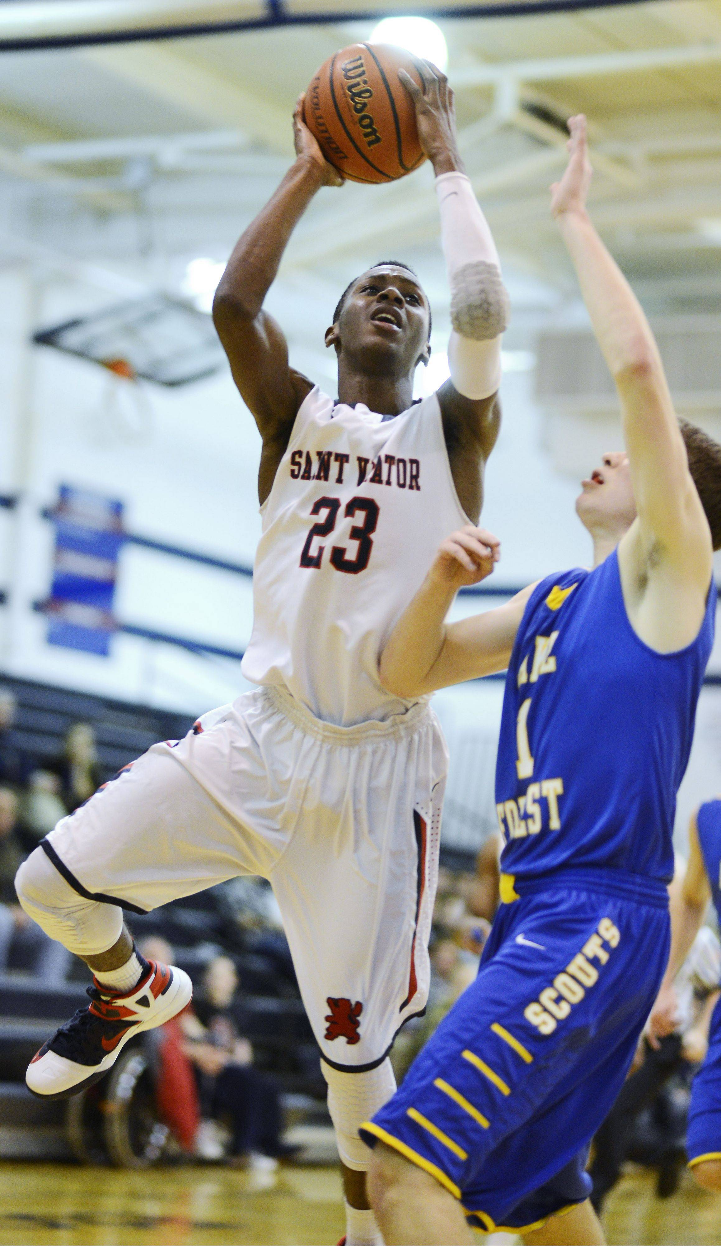 St. Viator's Ore Arogundade attempts a short jump shot against Lake Forest defender Ben Simpson during Tuesday's nonconference game in Arlington Heights.