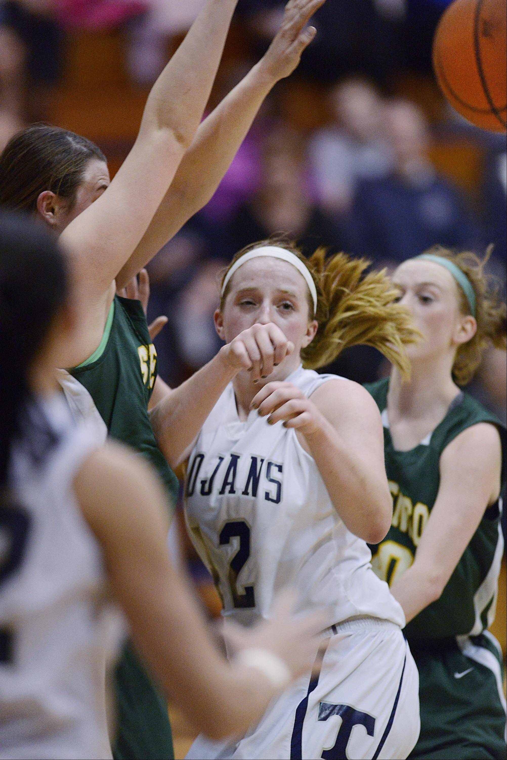 Cary-Grove's Olivia Jakubicek (42) passes out of a crowd against Stevenson Wednesday in Cary.