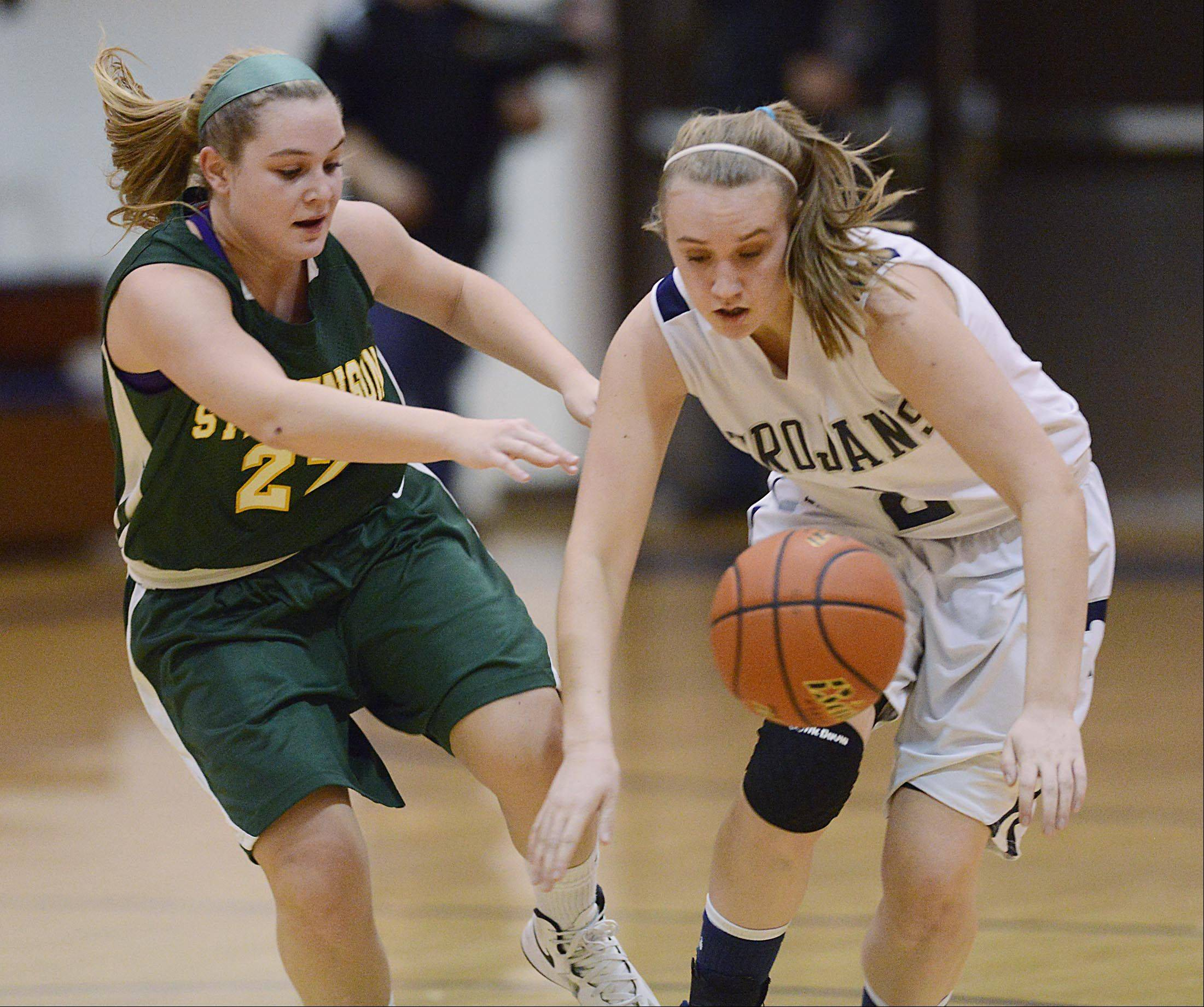 Stevenson's Kari Moffat causes Cary-Grove's Katie Barker to lose control of the ball Wednesday in Cary.