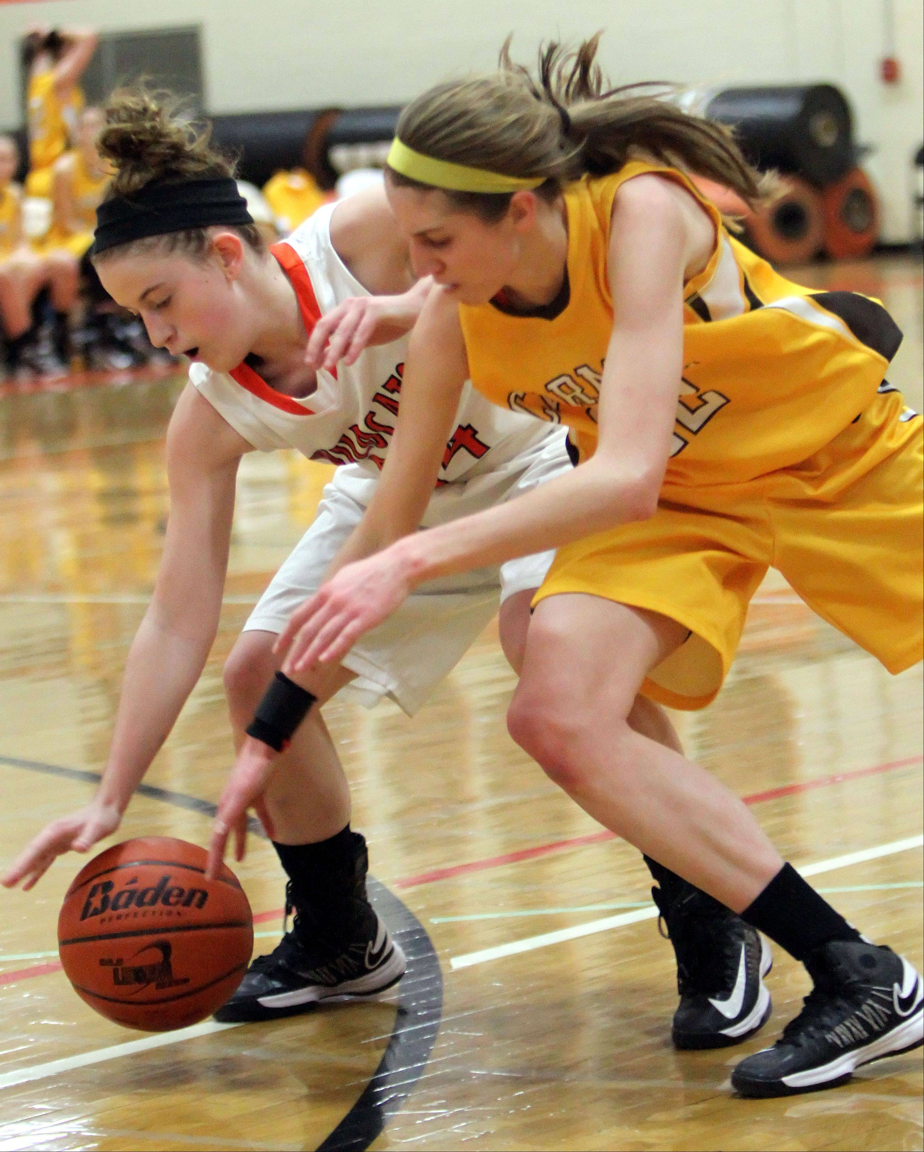 Libertyville's Rosie Lynch, left, and Carmel's Claire Ogrinc battle for a loose ball Wednesday night at Libertyville.