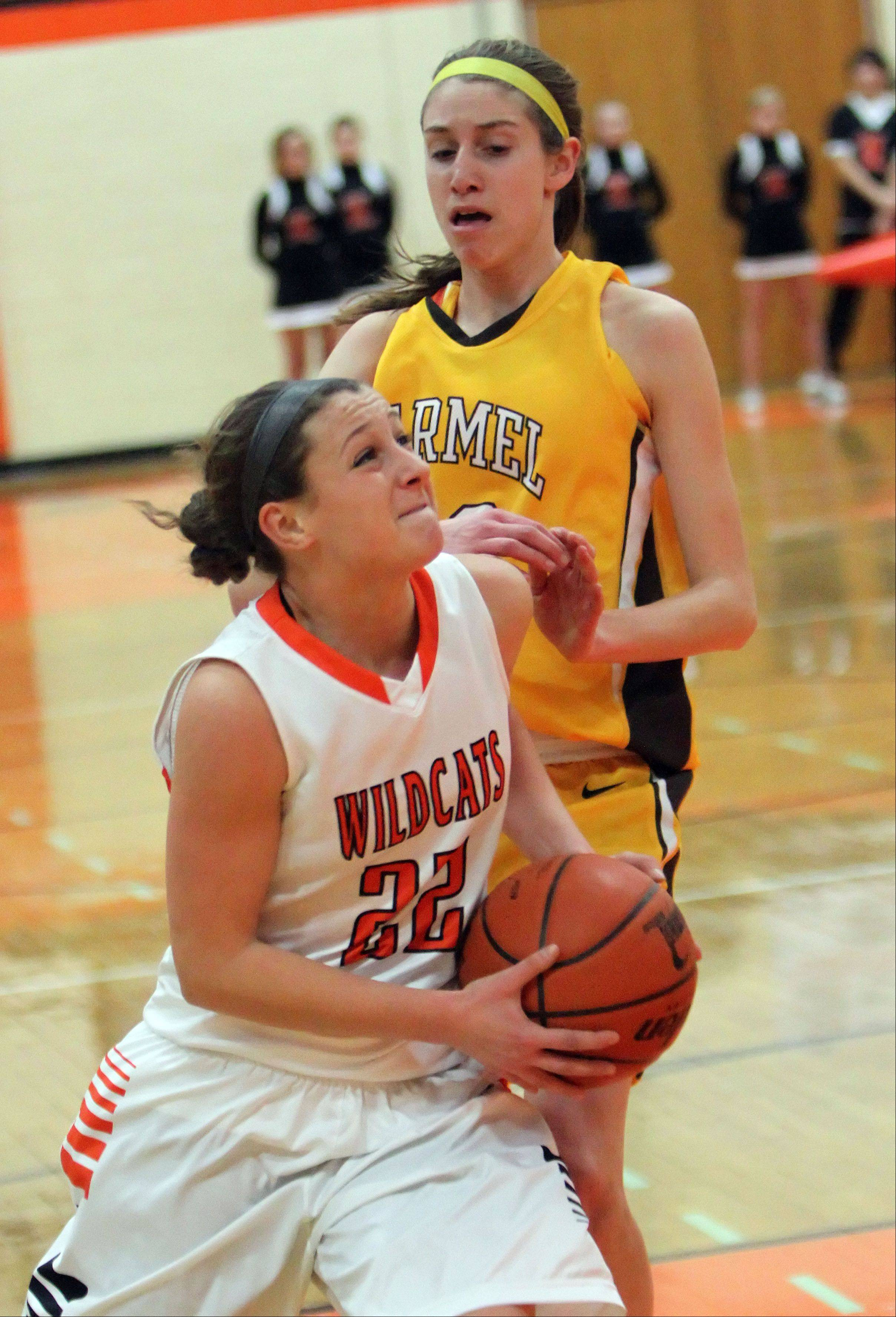 Libertyville's Olivia Mayer, left, drives on Carmel's Claire Ogrinc Wednesday night at Libertyville.