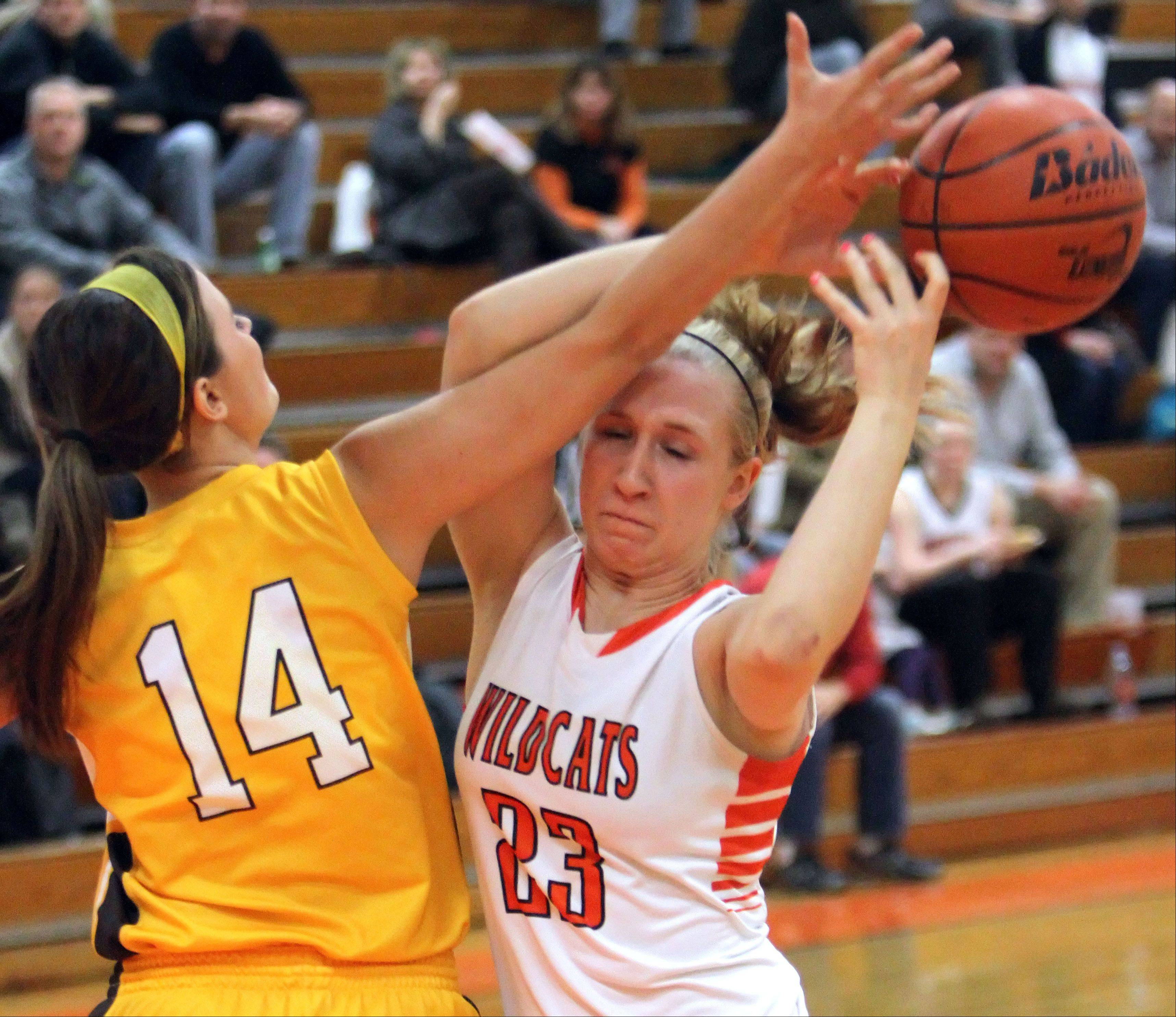 Libertyville's Dana Kym, right, and Carmel's Cassidy Kloss battle for a rebound Wednesday at Libertyville.