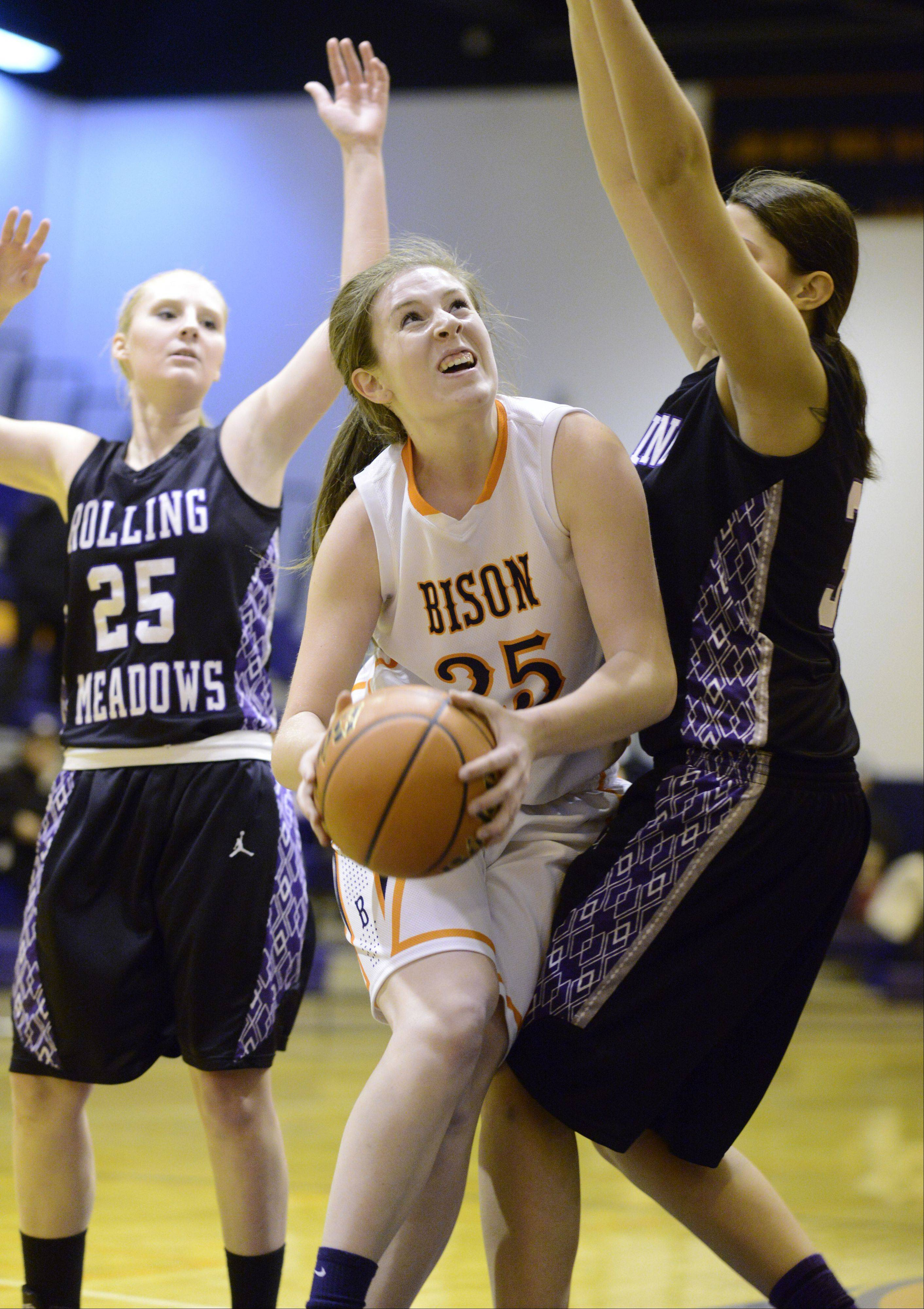 Buffalo Grove's Alyssa Mills tries to drive to the basket between Rollin Meadows' Allie Kemph, left, and Ashley Montanez.