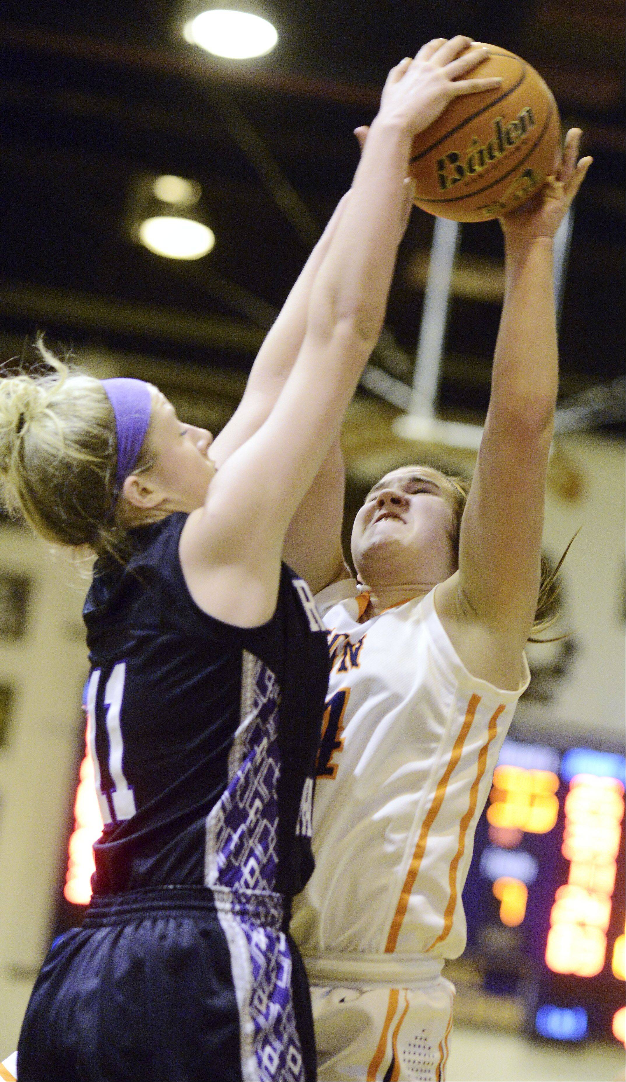 Buffalo Grove's Angela Budimir has her shot blocked by Rolling Meadows' Jenny Vliet during Wednesday's game.