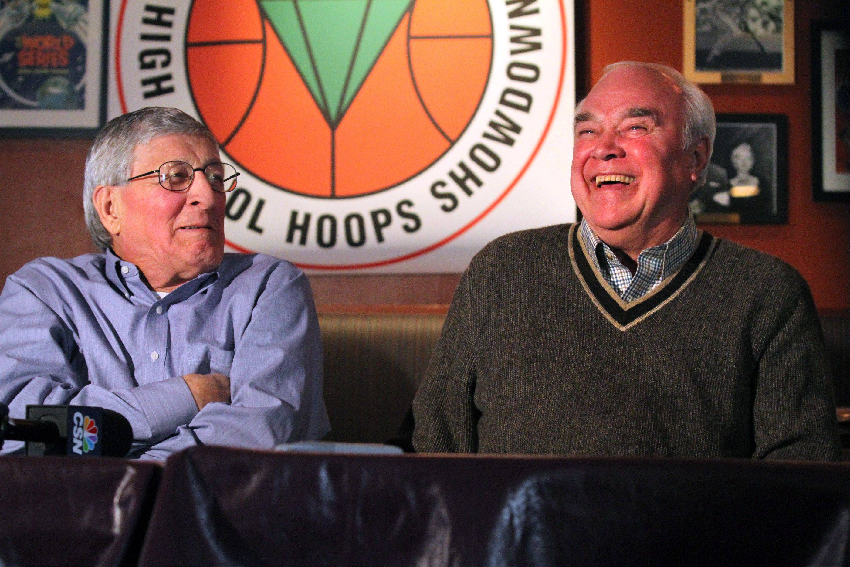St. Joseph boys basketball coach Gene Pingatore, left, and West Aurora coach Gordie Kerkman, whose teams will play each other in game three of the National Guard High School Hoops Showdown at the Sears Centre on Saturday, enjoy a moment during a news conference at Lou Malnati's Pizzeria in Schaumburg on Wednesday.