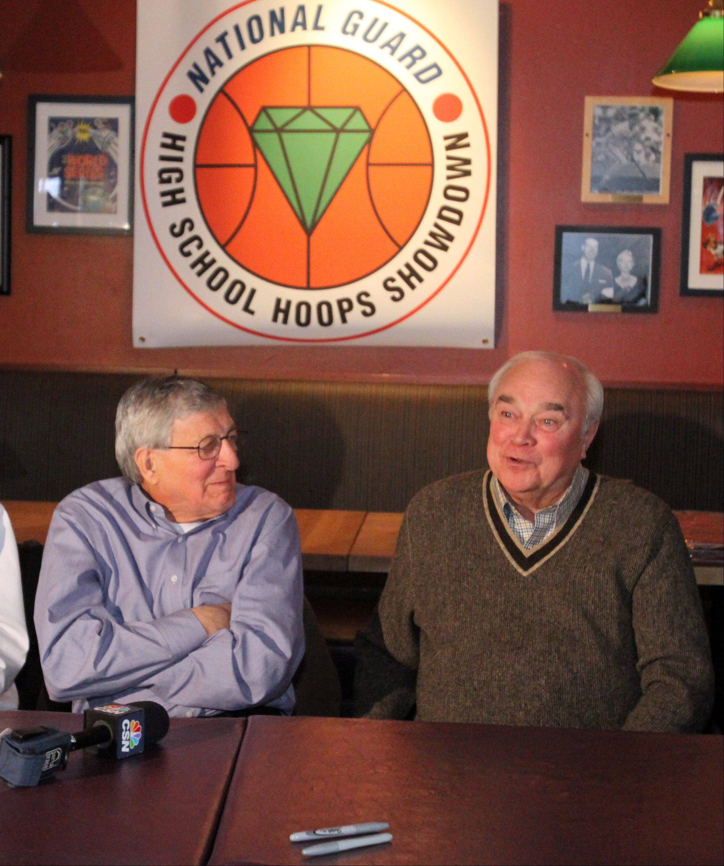 St. Joseph coach Gene Pingatore, left, and West Aurora coach Gordie Kerkman, whose teams will play each other in game three of the National Guard High School Hoops Showdown on Saturday at the Sears Centre, speak during a news conference at Lou Malnati's Pizzeria in Schaumburg on Wednesday.
