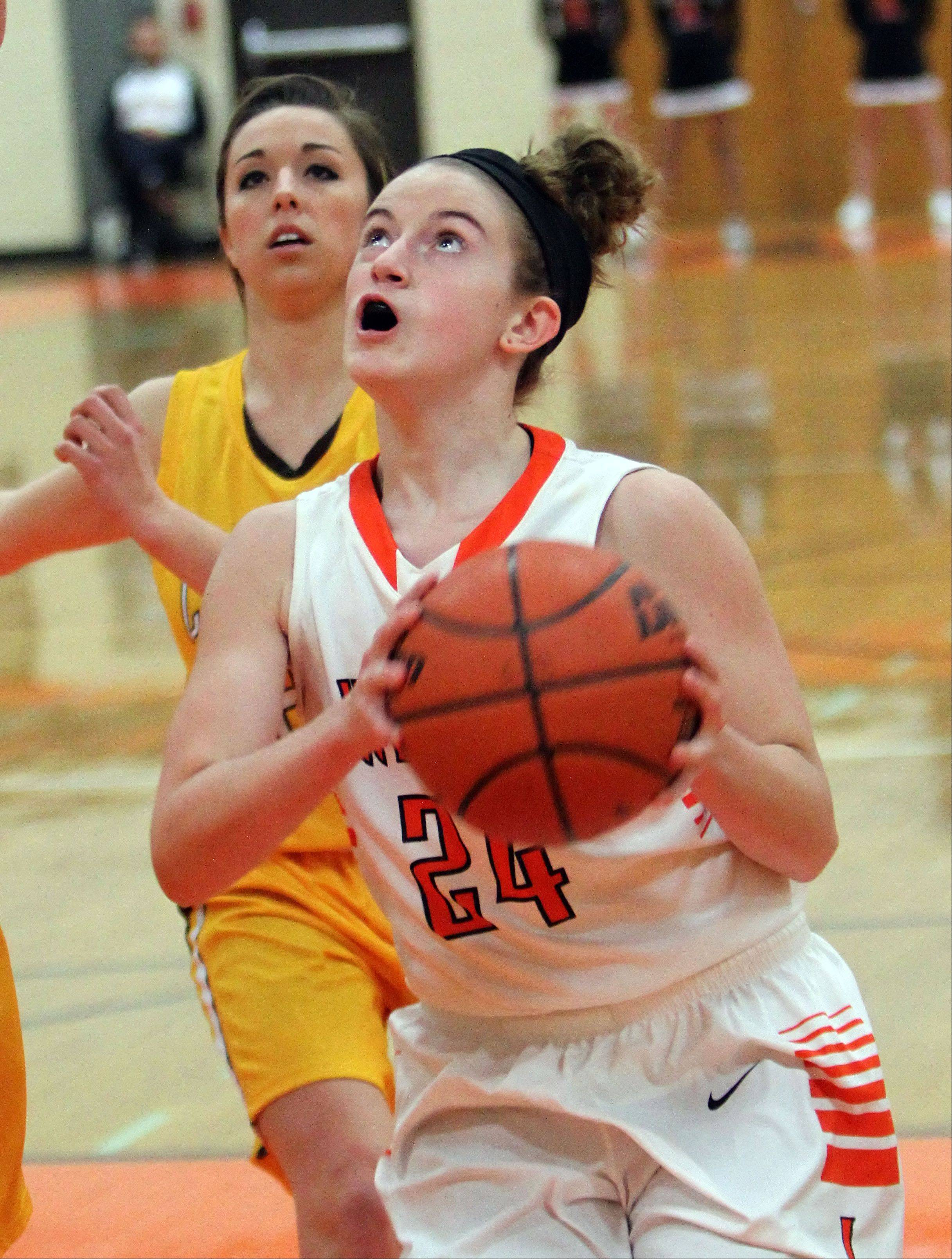 Libertyville's Rosie Lynch, right, drives on Carmel's Nicole Bitter.