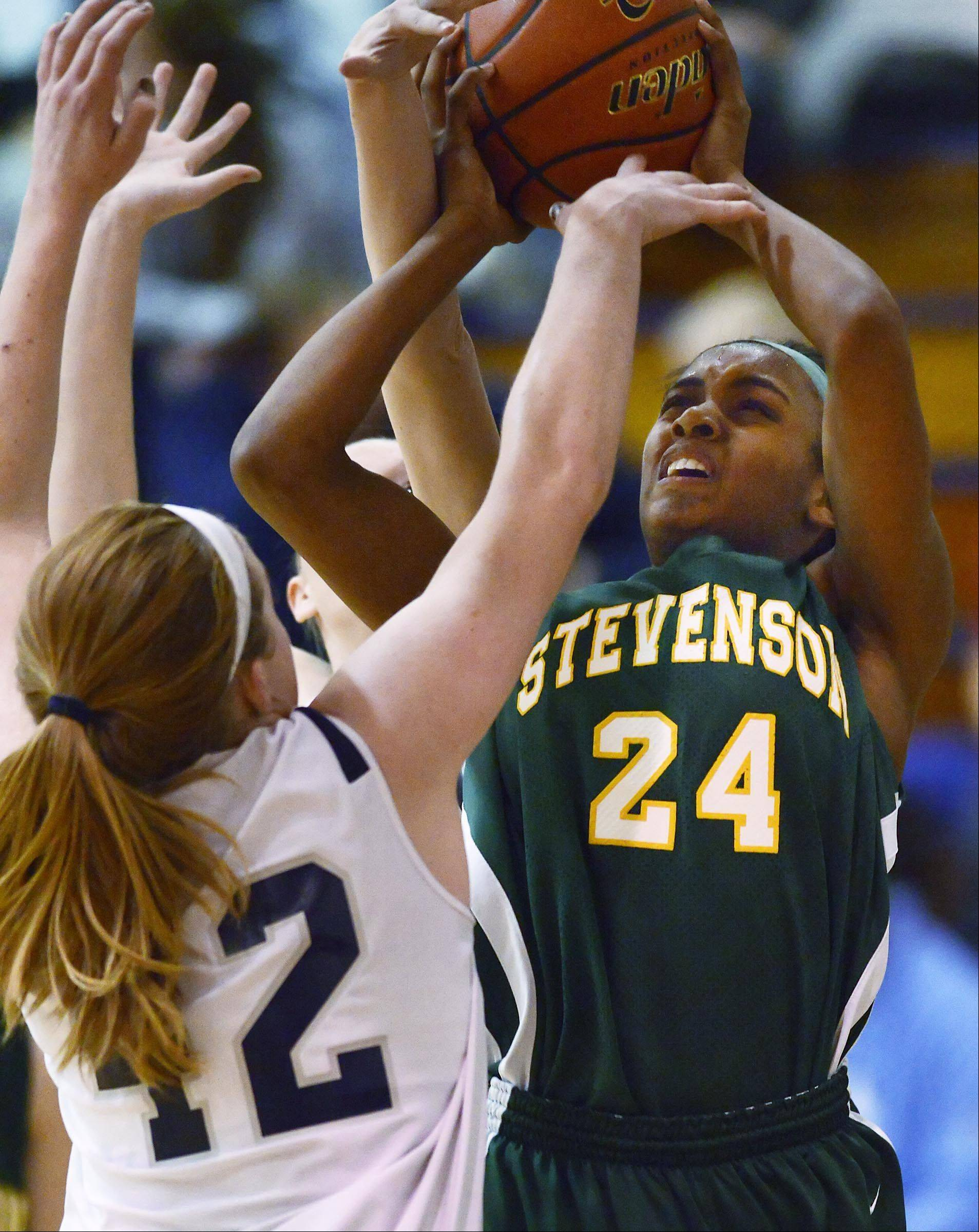 Cary-Grove's Olivia Jakubicek and Morgan Lee defend against Stevenson's Taylor Buford.
