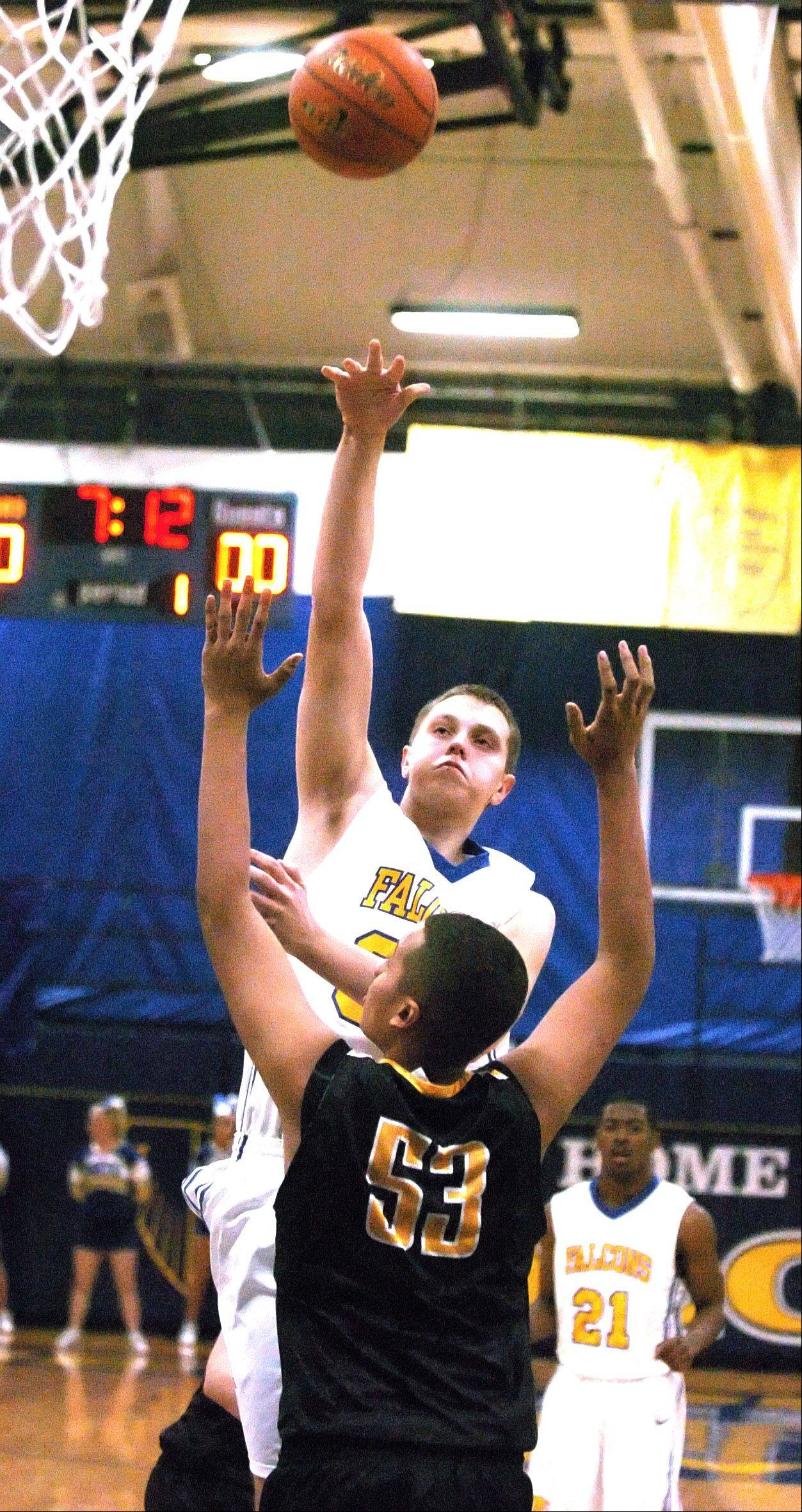 Andrew Zelis of Wheaton North puts up a shot over Barret Benson of Hinsdale South during the Hinsdale South at Wheaton North game Tuesday.