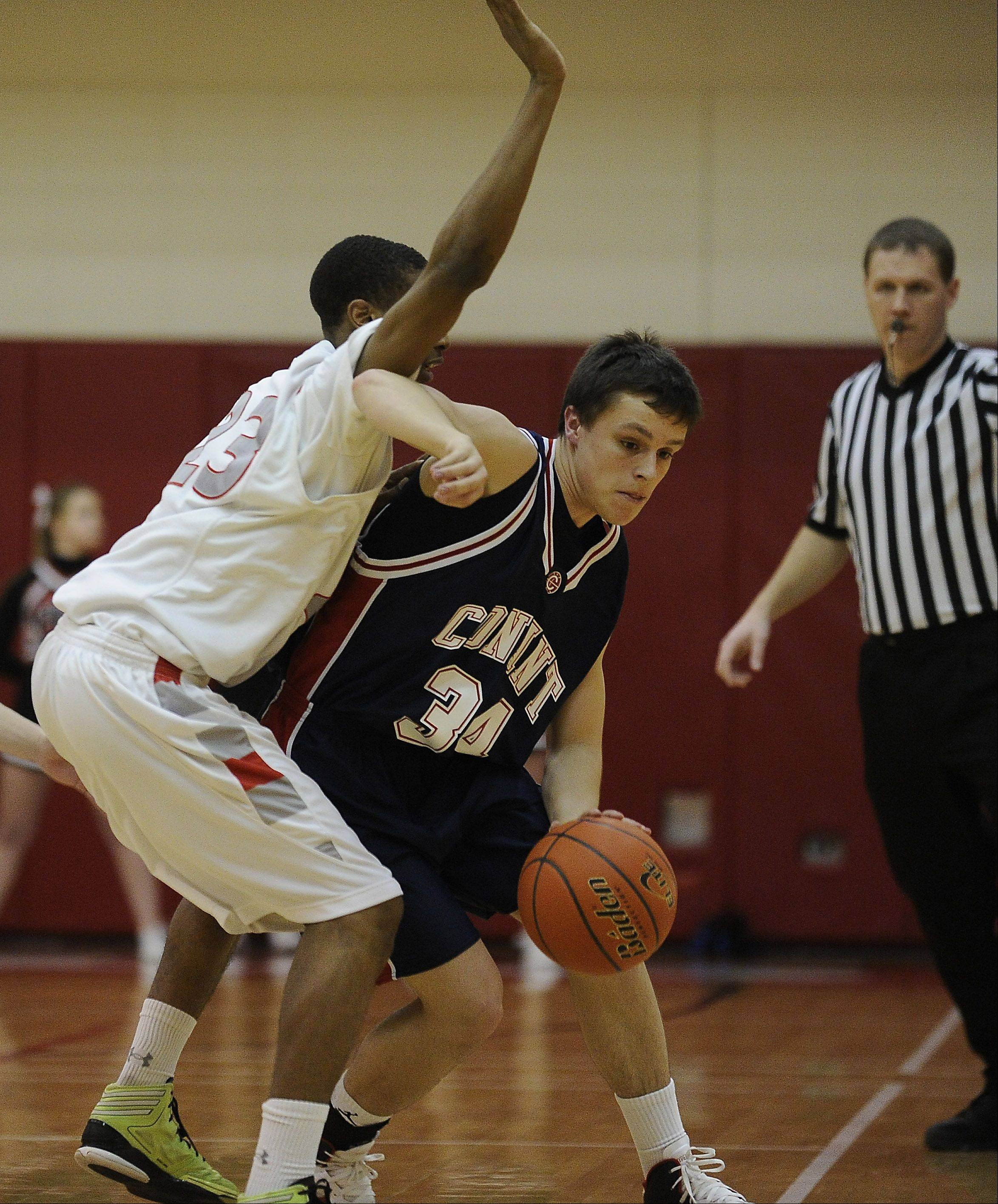 Conant's Mark Monti drives past Palatine's Roosevelt Smart in the first half of MSL West play Thursday at Palatine.
