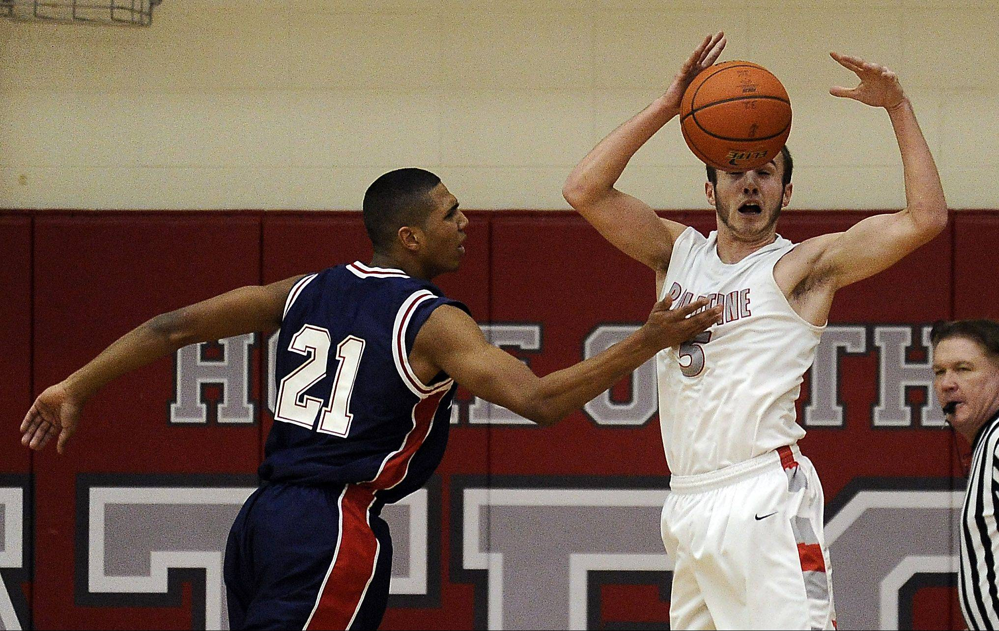 Palatine's Chris Macahon tries to control the ball and keep it away from Conant's D'Angelo McBride in the first half on Thursday at Palatine.