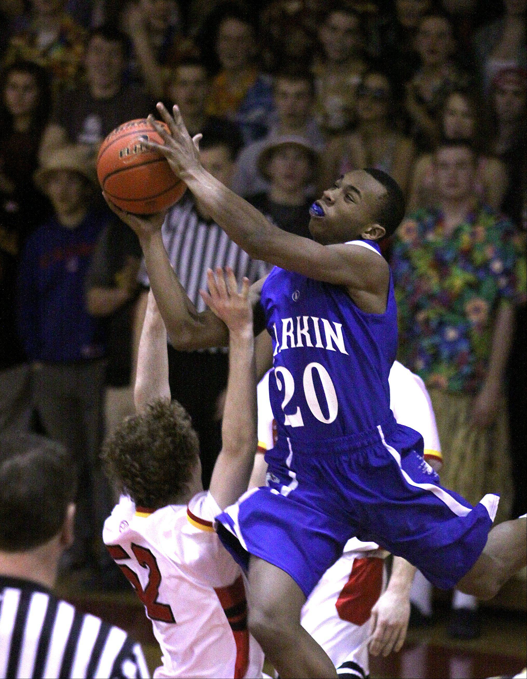 Larkin's Quentin Ruff soars toward the hoop during a varsity basketball game at Batavia on Thursday night.