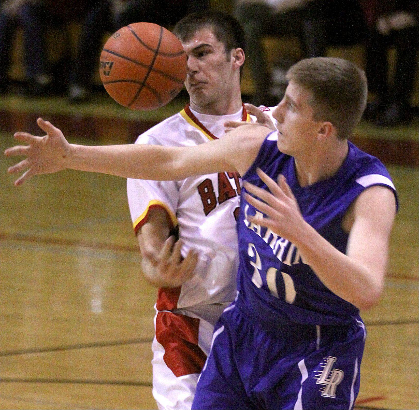 Batavia's Zach Strittmatter, left, and Larkin's Brayden Royse pursue a loose ball during a varsity basketball game at Batavia on Thursday night.